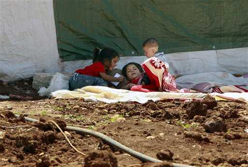 Bambini siriani in un campo profughi in Libano