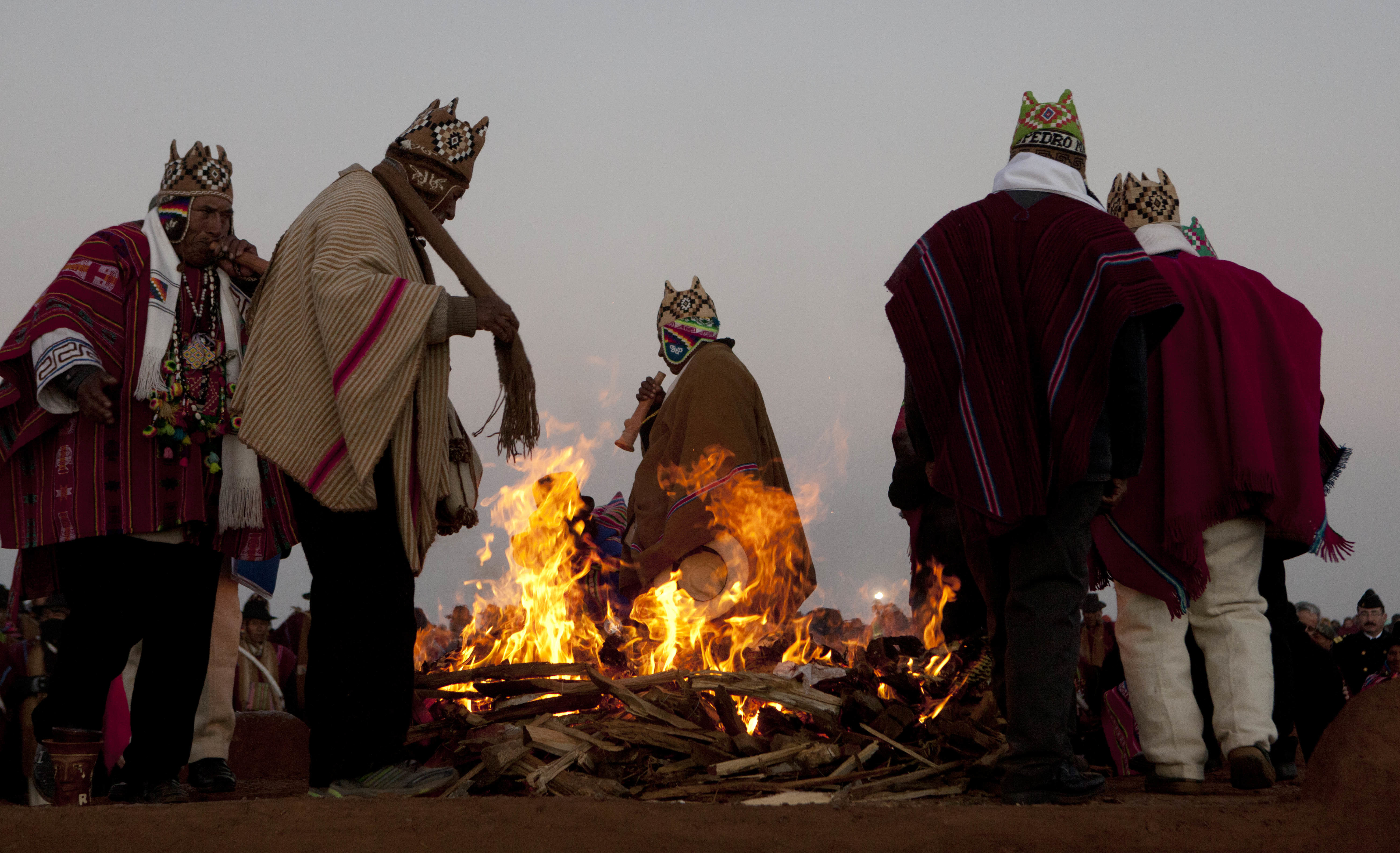 Andean religious leaders perform a New Year's ritual at the ruins of the ancient civilization of Tiwanaku, Bolivia, early Wednesday, June 21, 2017. Bolivia's Aymara Indians are celebrating the year 5,525 as well as the Southern Hemisphere's winter solstice, which marks the start of a new agricultural cycle. (AP Photo/Juan Karita)