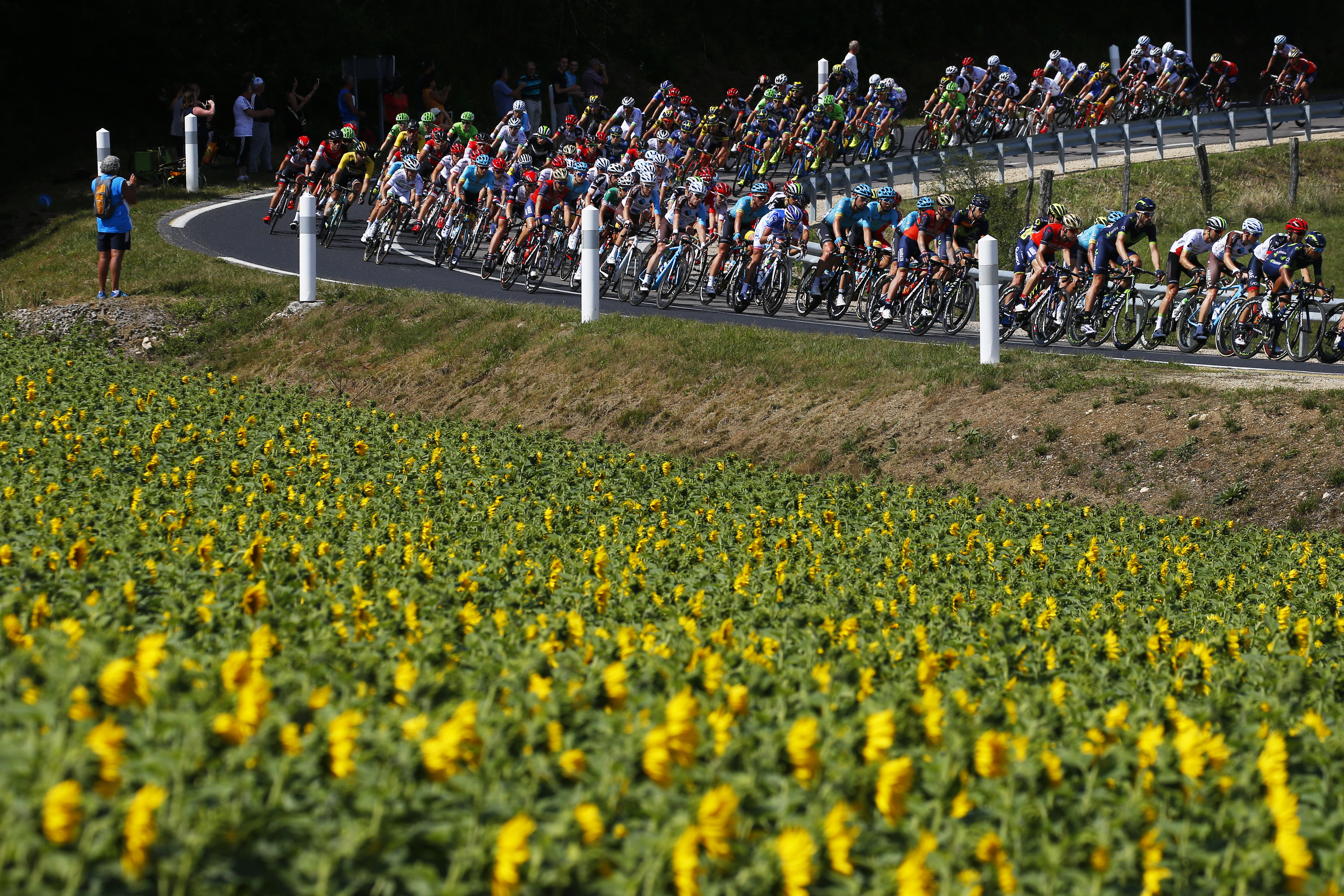 The pack speeds downhill during the fourth stage of the Tour de France cycling race over 207.5 kilometers (129 miles) with start in Mondorf-les-Bains, Luxembourg, and finish in Vittel, France, Tuesday, July 4, 2017. (AP Photo/Peter Dejong)