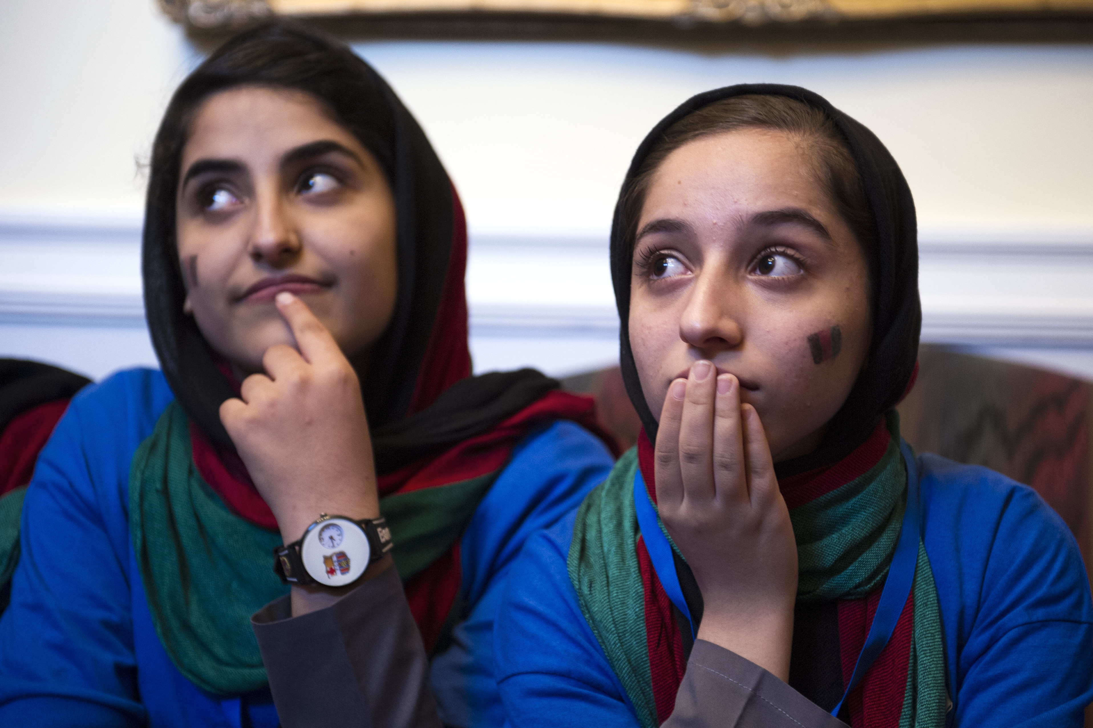 Afghanistan's FIRST Global Challenge team member Lida Azizi, left, and Fatemah Qaderyan meet with reporters following the opening ceremony in Washington, Sunday, July 16, 2017. Twice rejected for U.S. visas, the all-girls robotics team arrived in Washington on Saturday and will compete against entrants from more than 150 countries in the three-day high school competition. It's the first annual robotics competition designed to encourage youths to pursue careers in math and science. (AP Photo/Cliff Owen)