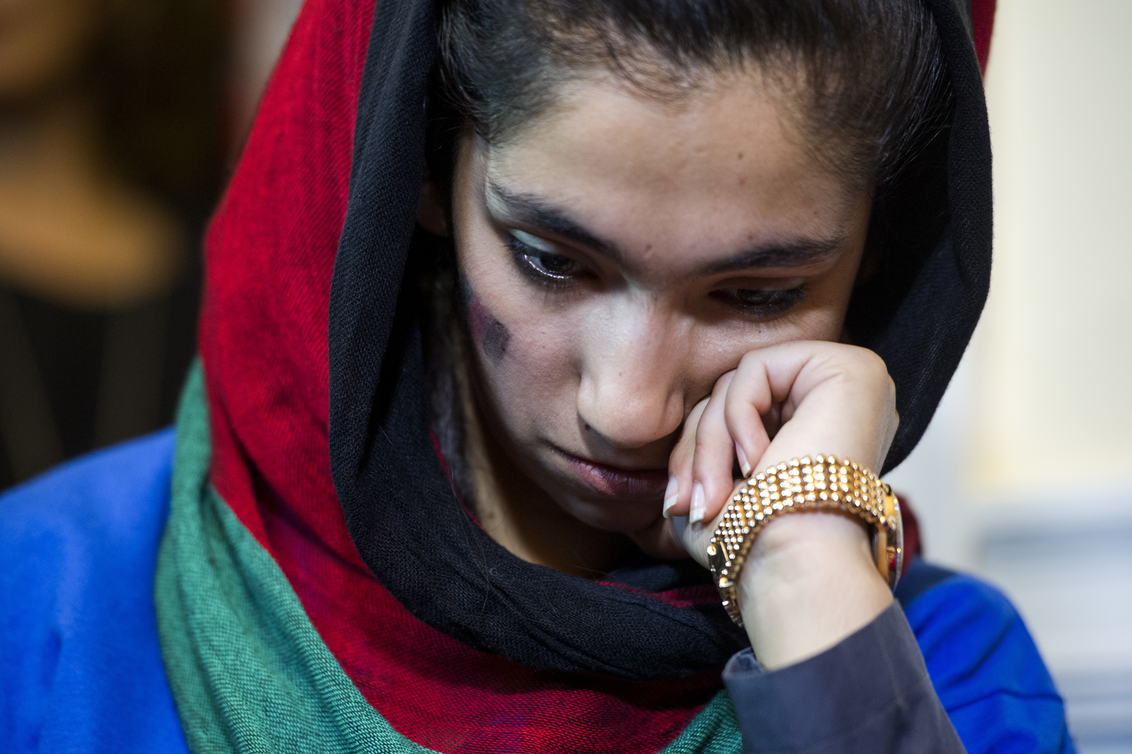 Afghanistan's FIRST Global Challenge team member Yasimin Yasinzadah meets with reporters following the opening ceremony in Washington, Sunday, July 16, 2017. (AP Photo/Cliff Owen)