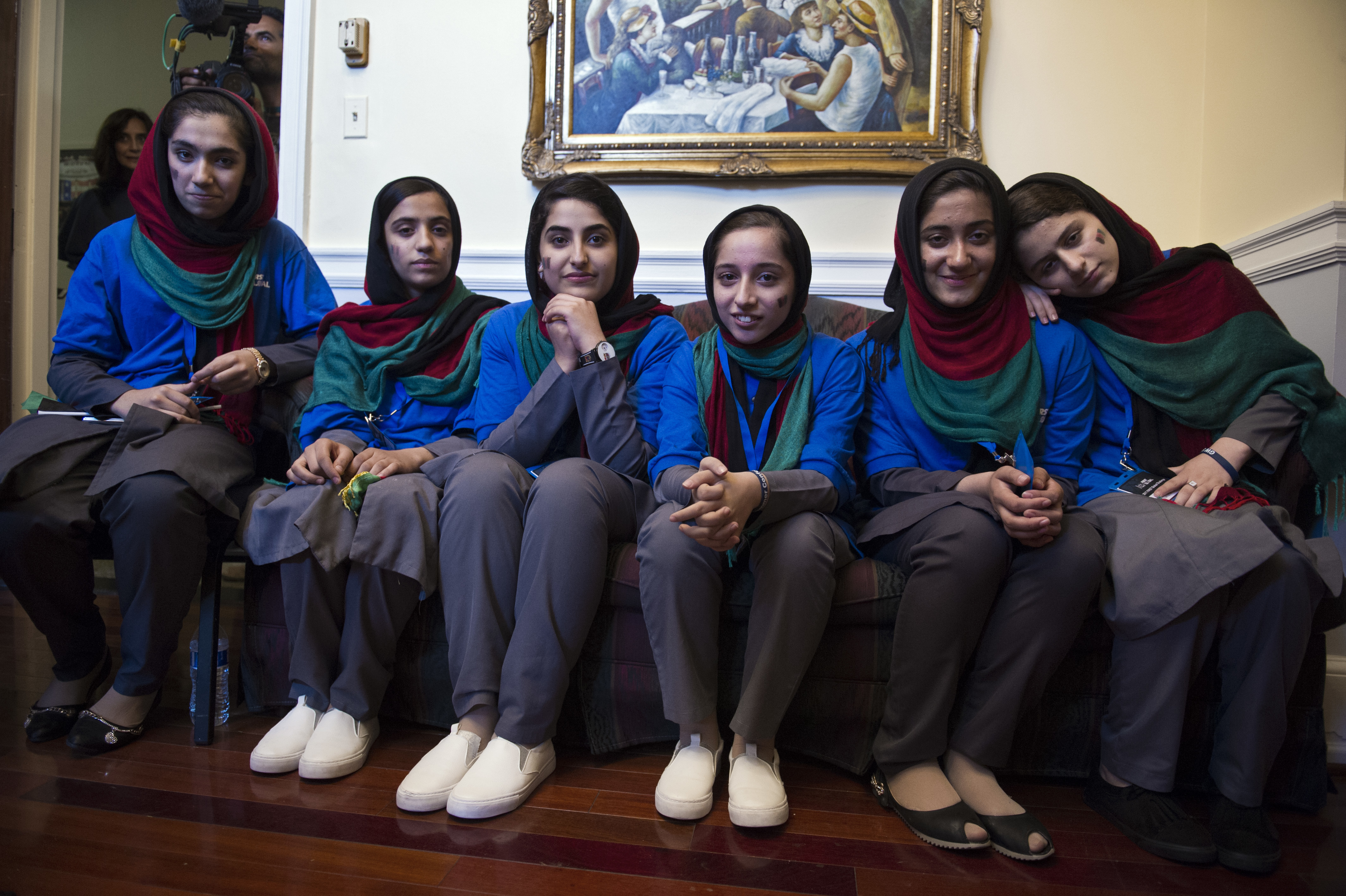 Afghanistan's FIRST Global Challenge team meet with reporters following the opening ceremony in Washington, Sunday, July 16, 2017. Twice rejected for U.S. visas, the all-girls robotics team arrived in Washington on Saturday and will compete against entrants from more than 150 countries in the three-day high school competition. It's the first annual robotics competition designed to encourage youths to pursue careers in math and science. (AP Photo/Cliff Owen)