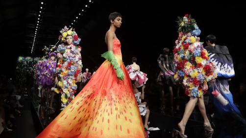 Models wear creations as part of the Moschino women's Fall/Winter 2018/19 fashion collection, presented in Milan, Italy, Thursday, Sept. 21, 2017. (AP Photo/Luca Bruno)