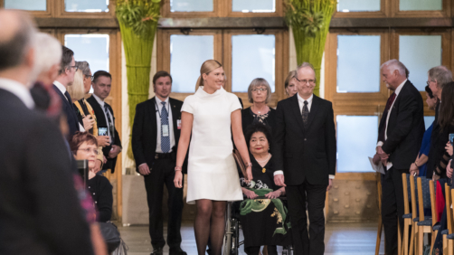 Hiroshima Survivor Setsuko Thurlow and Beatrice Fihn, leader of International Campaign to Abolish Nuclear Weapons (ICAN) in Oslo City Hall on the occasion of the award ceremony of the Nobel Peace Prize to ICAN, in Oslo, Sunday, Dec. 10, 2017. At right is Henrik Syse, member of the Nobel committee. (Berit Roald/NTB Scanpix via AP)