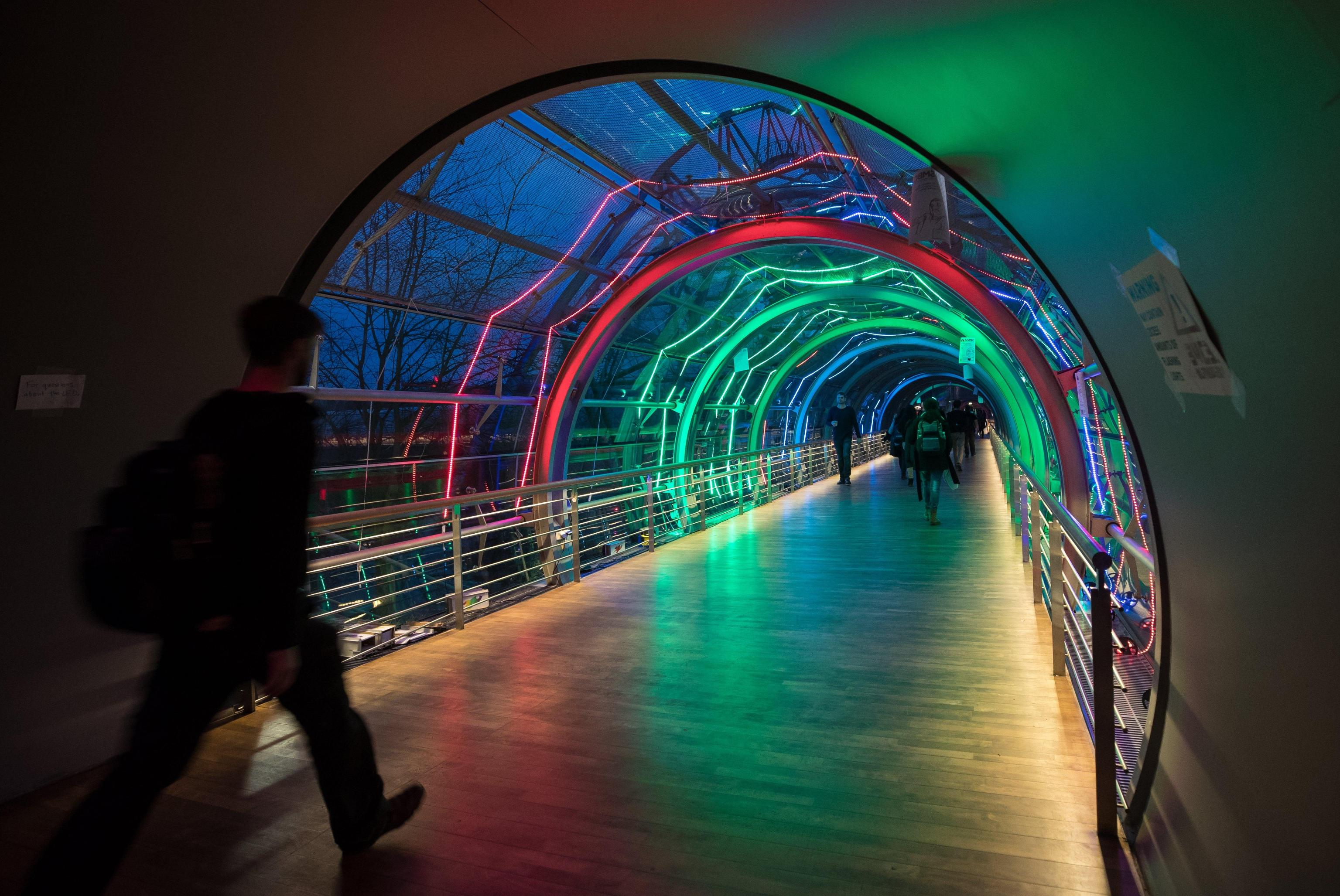 Visitors pass through a tunnel at the Chaos Communication Congress (CCC) in Leipzig, Germany, 27 December 2017. The world's largest non-commercial hacker meeting takes place until 30 December 2017.  EPA/HAYOUNG JEON