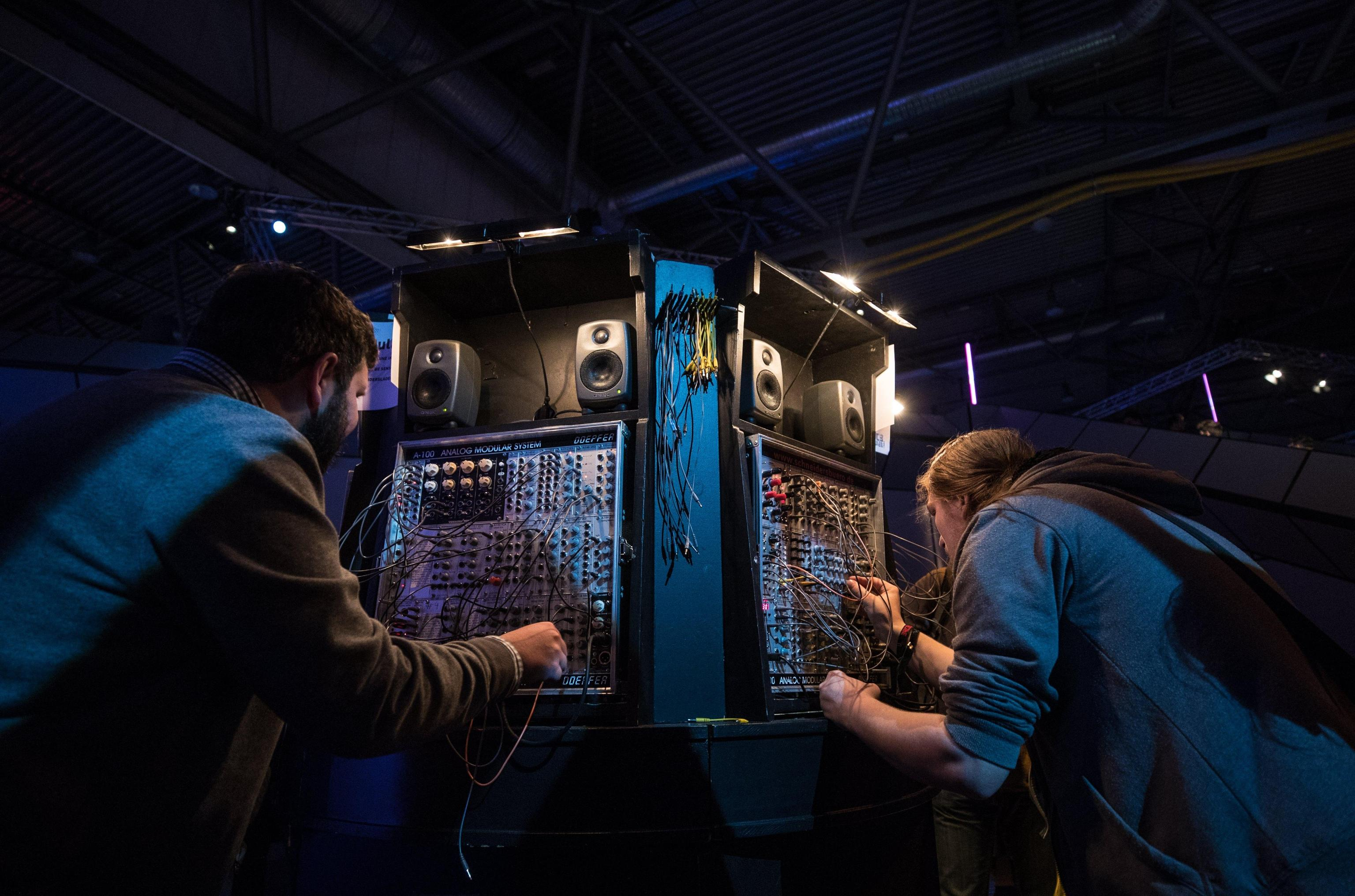 Visitors try a sound machine at the Chaos Communication Congress (CCC) in Leipzig, Germany, 27 December 2017. The world's largest non-commercial hacker meeting takes place until 30 December 2017.  EPA/HAYOUNG JEON