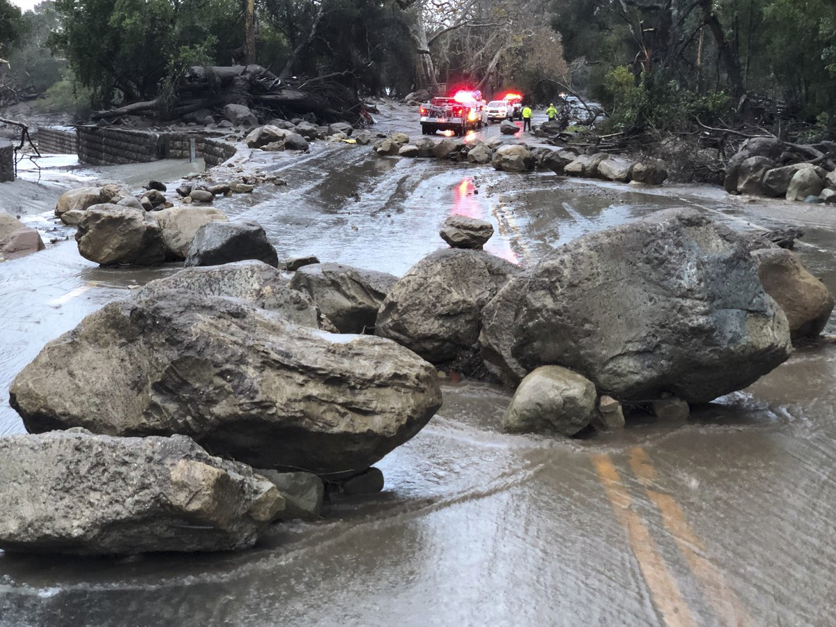 In this photo provided by Santa Barbara County Fire Department,   mud and debris flow on the roadway due to heavy rain in Montecito. Calif., Tuesday, Jan. 9, 2018.   Heavy rains pounding Southern California for a second day are causing floods and loosening hillsides as officials in fire-ravaged communities warn people to stay off roads over fears of mud and debris flows. (Mike Eliason/Santa Barbara County Fire Department via AP)