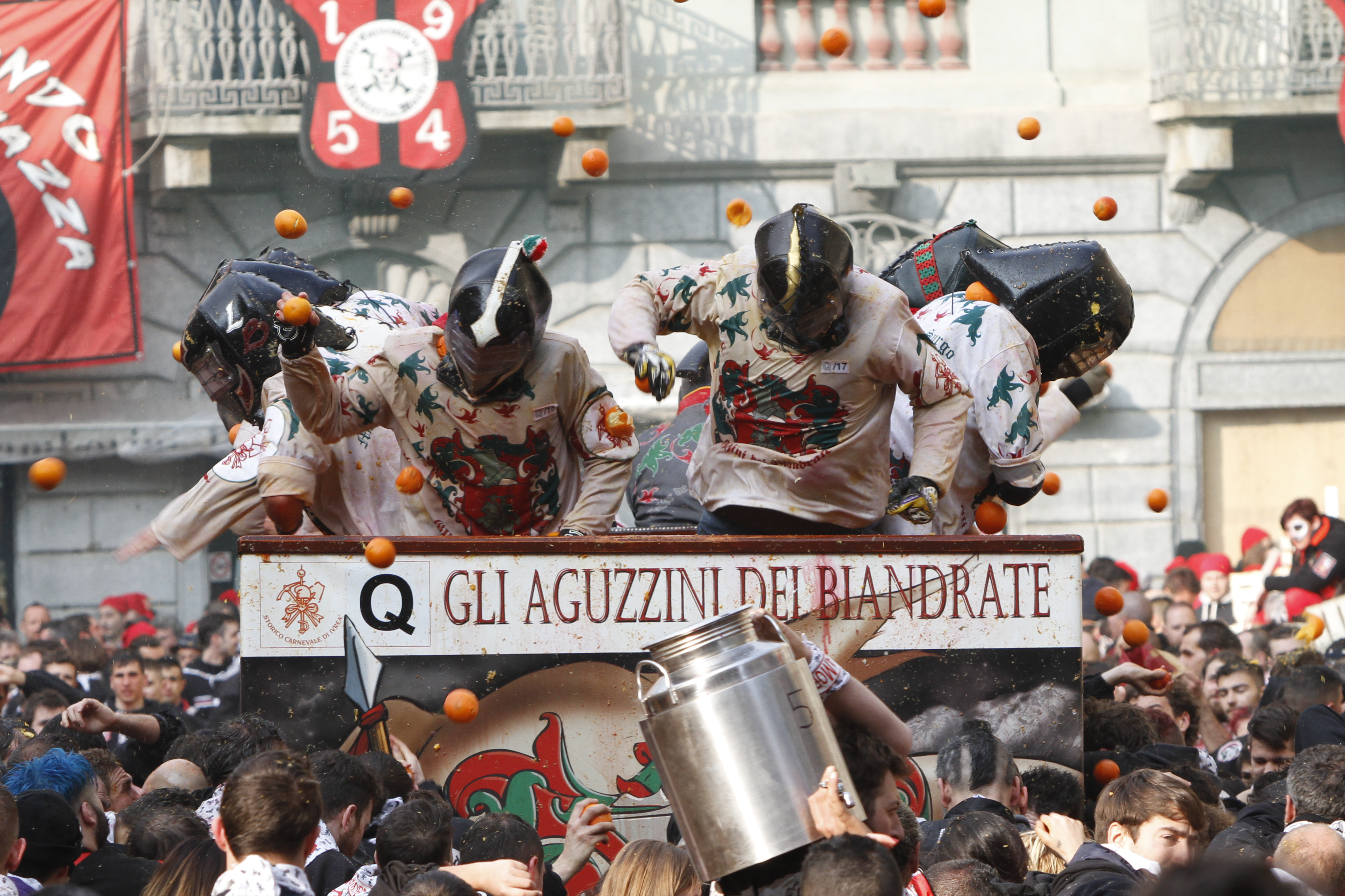 Orange throwers rally under a cart as part of the 'Battle of the Oranges' at Ivrea historical Carnival. The Battle of the Oranges is the main event of Ivrea Carnival in Italy on February 11, 2018. (Photo by Marco Destefanis/Pacific Press/Sipa USA)(Sipa via AP Images)