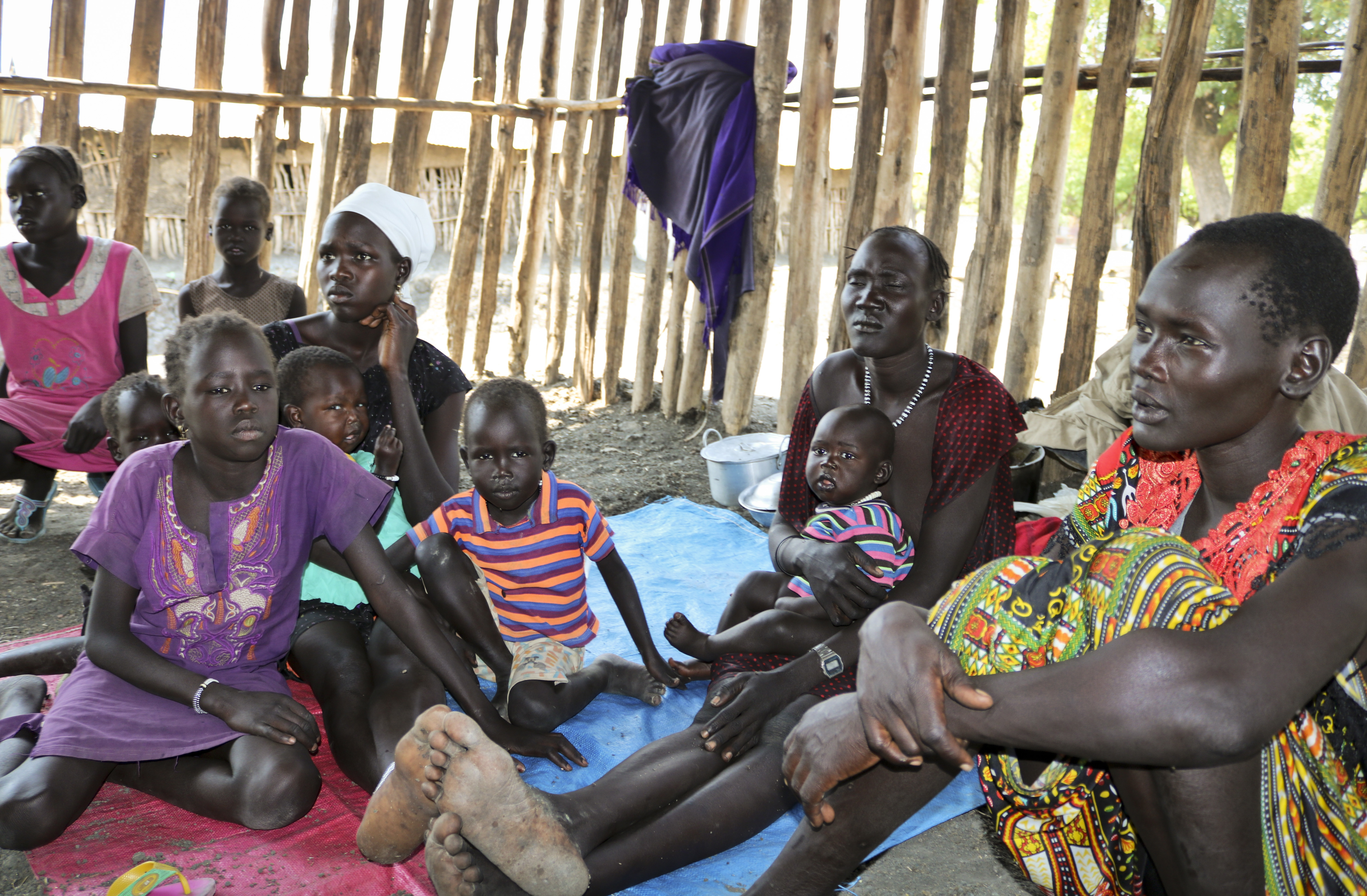 In this photo taken Friday, Jan. 19, 2018, recently displaced families who arrived five days before claiming that government troops attacked their towns, shelter in a run-down school in Akobo, near the Ethiopian border, in South Sudan. United Nations peacekeepers are returning to the only U.N. base in South Sudan