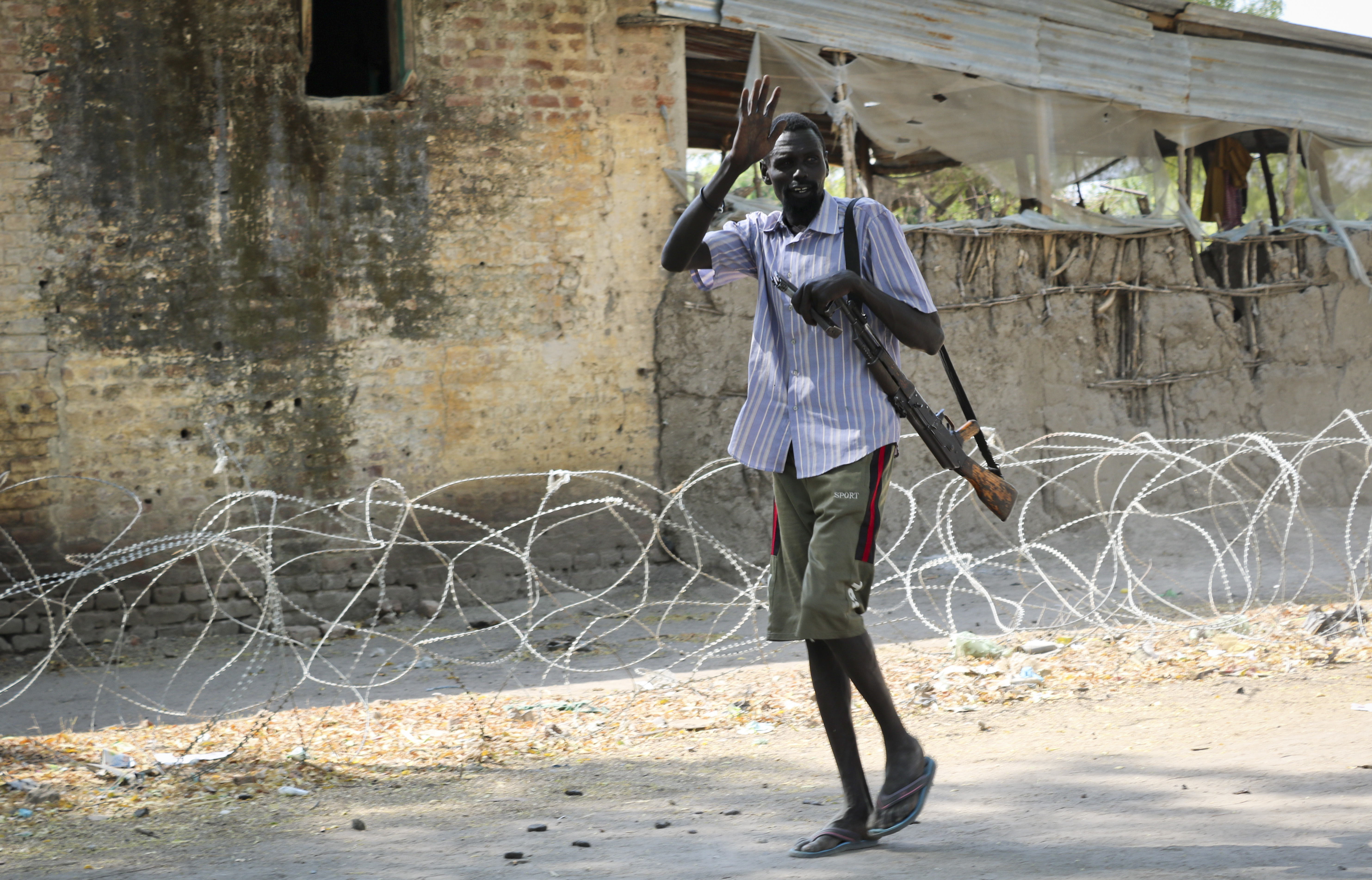 In this photo taken Friday, Jan. 19, 2018, a rebel fighter walks near their military base in Akobo, near the Ethiopian border, in South Sudan. United Nations peacekeepers are returning to the only U.N. base in South Sudan
