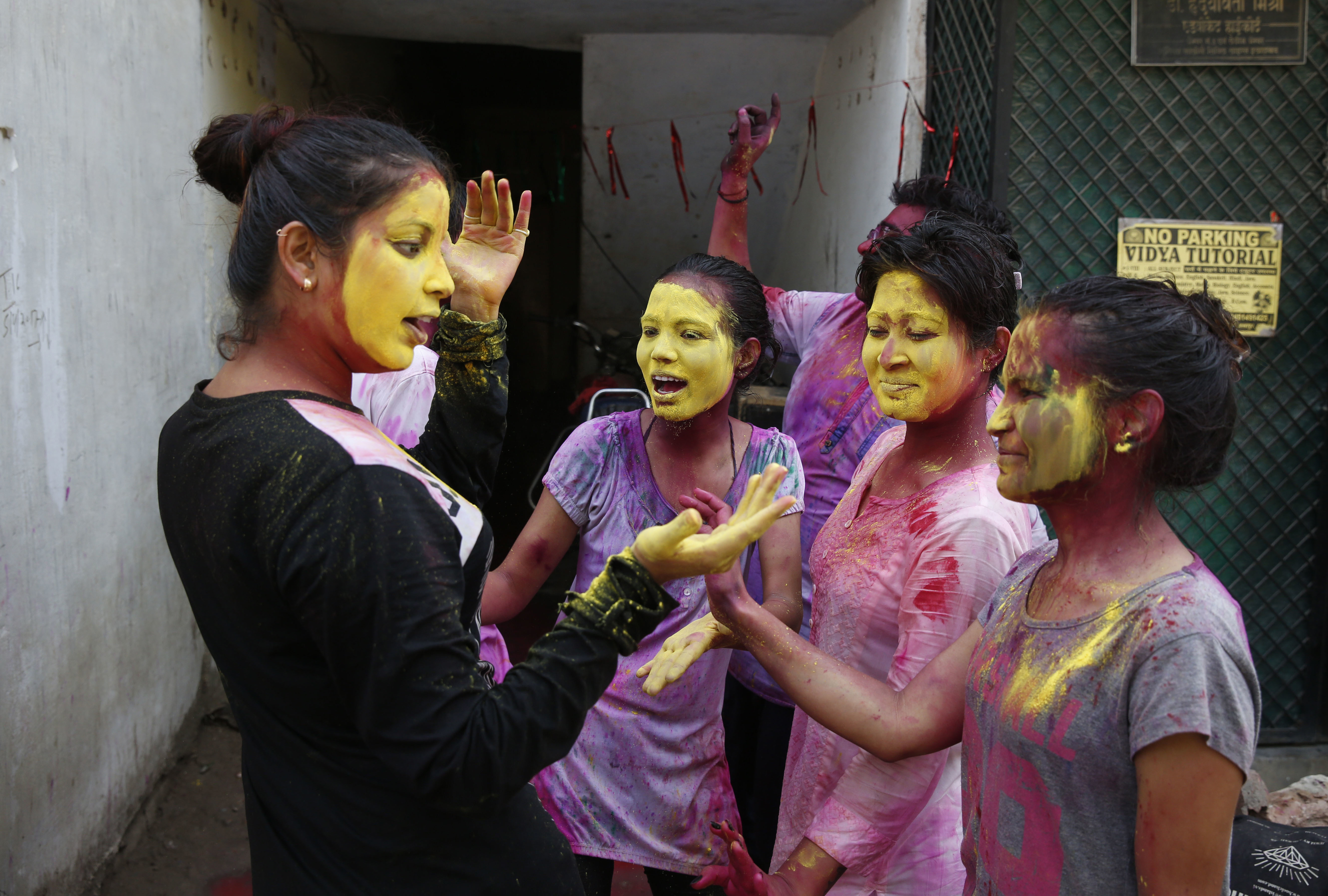 Indian revelers, faces smeared with colored powder, celebrate Holi, the Hindu festival of colors in Allahabad, India, Friday, March 2, 2018. The festival, a celebration of warm weather, good harvests and the defeat of evil, brings out millions of people, from toddlers to the elderly, to throw powder at one another and play with water balloons and squirt guns. (AP Photo/Rajesh Kumar Singh)