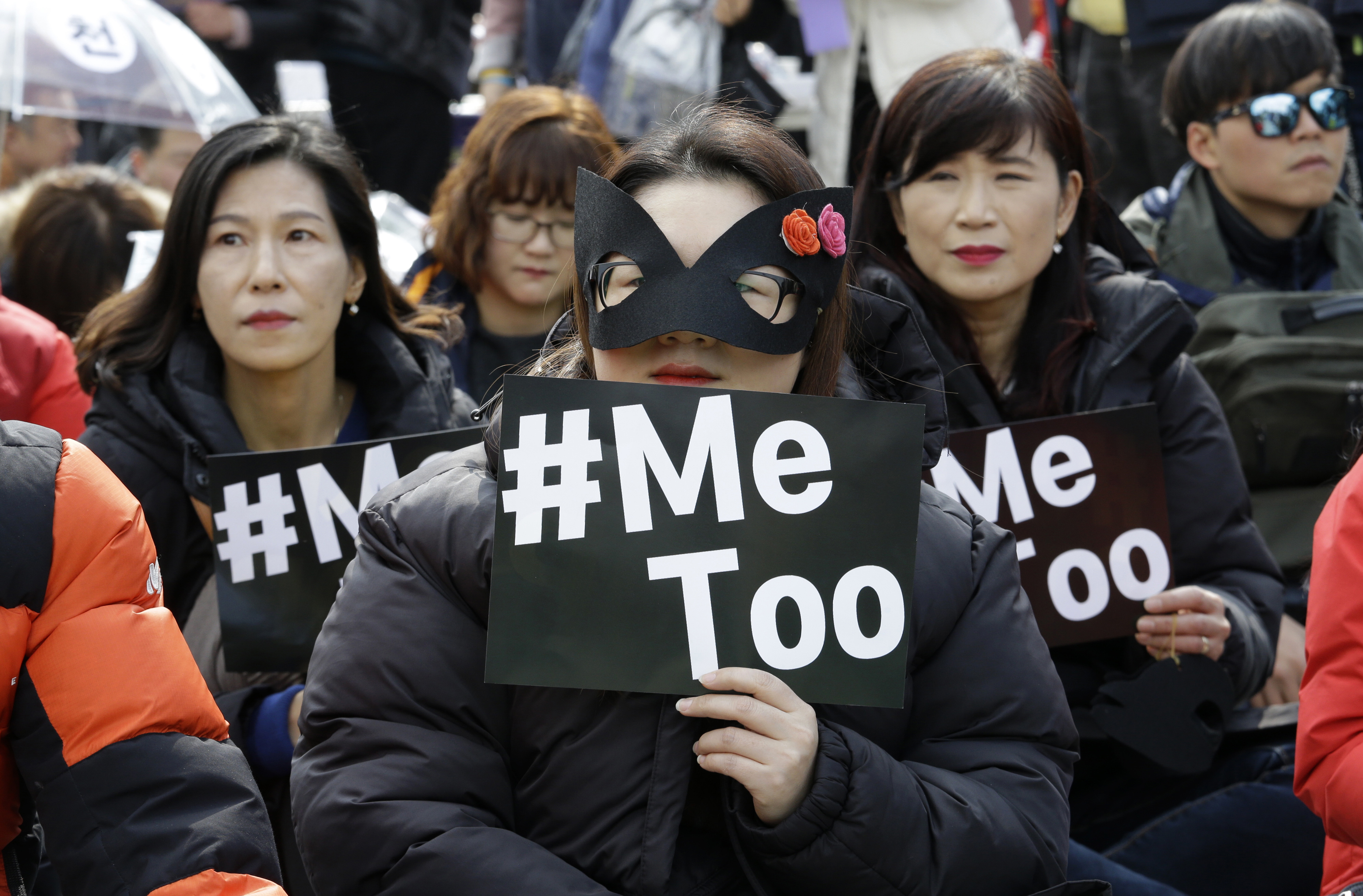 Female workers supporting the MeToo movement wearing black attend a rally to mark the International Women's Day in Seoul, South Korea, Thursday, March 8, 2018. (AP Photo/Ahn Young-joon)