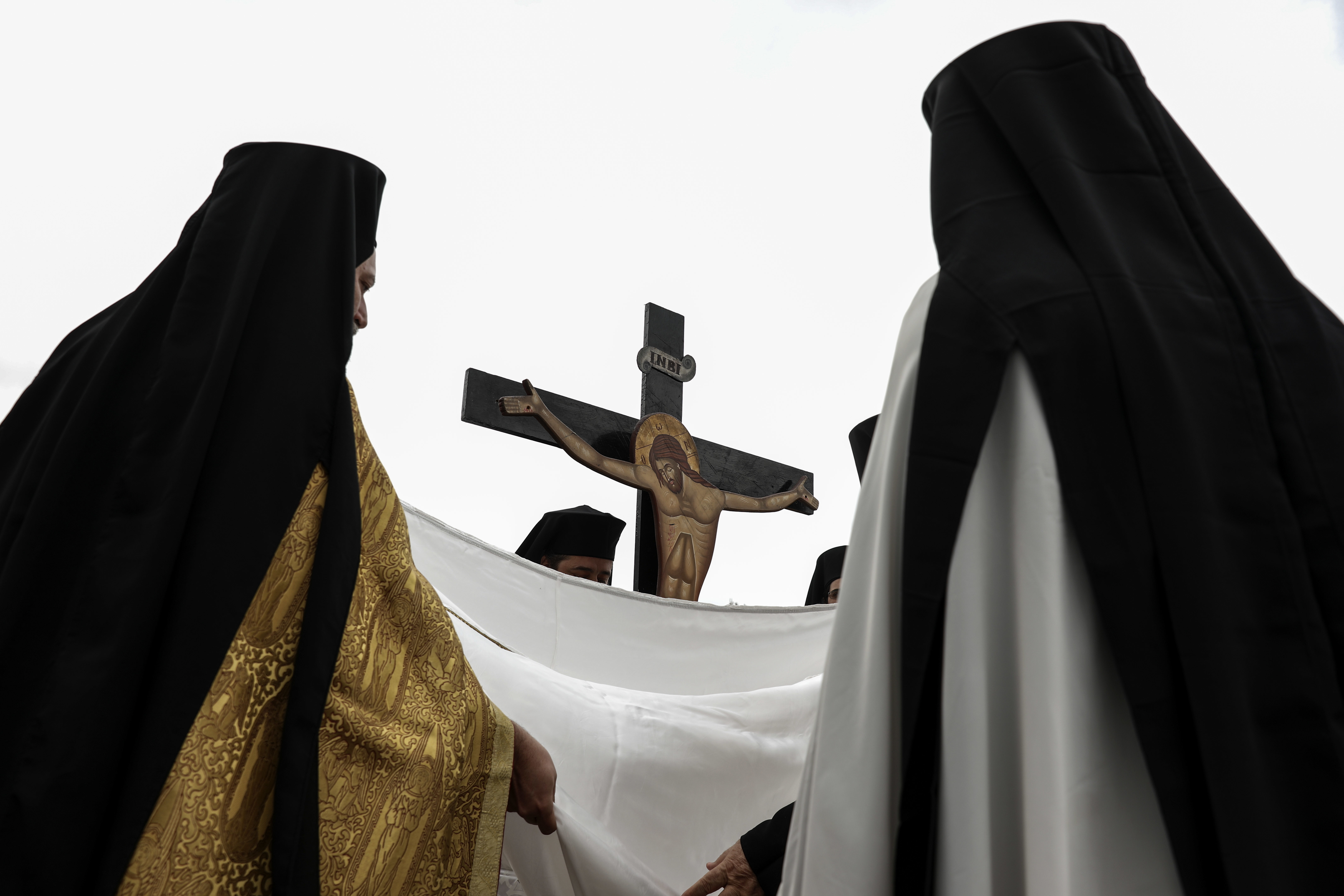 Greek Orthodox priests take part in a Good Friday reenactment of Christ being taken down from the crucifix, at the Pendeli Monastery, near Athens, on Friday, April 6, 2018. Orthodox Christians around the world celebrate Easter on Sunday, April 8. (AP Photo/Yorgos Karahalis)