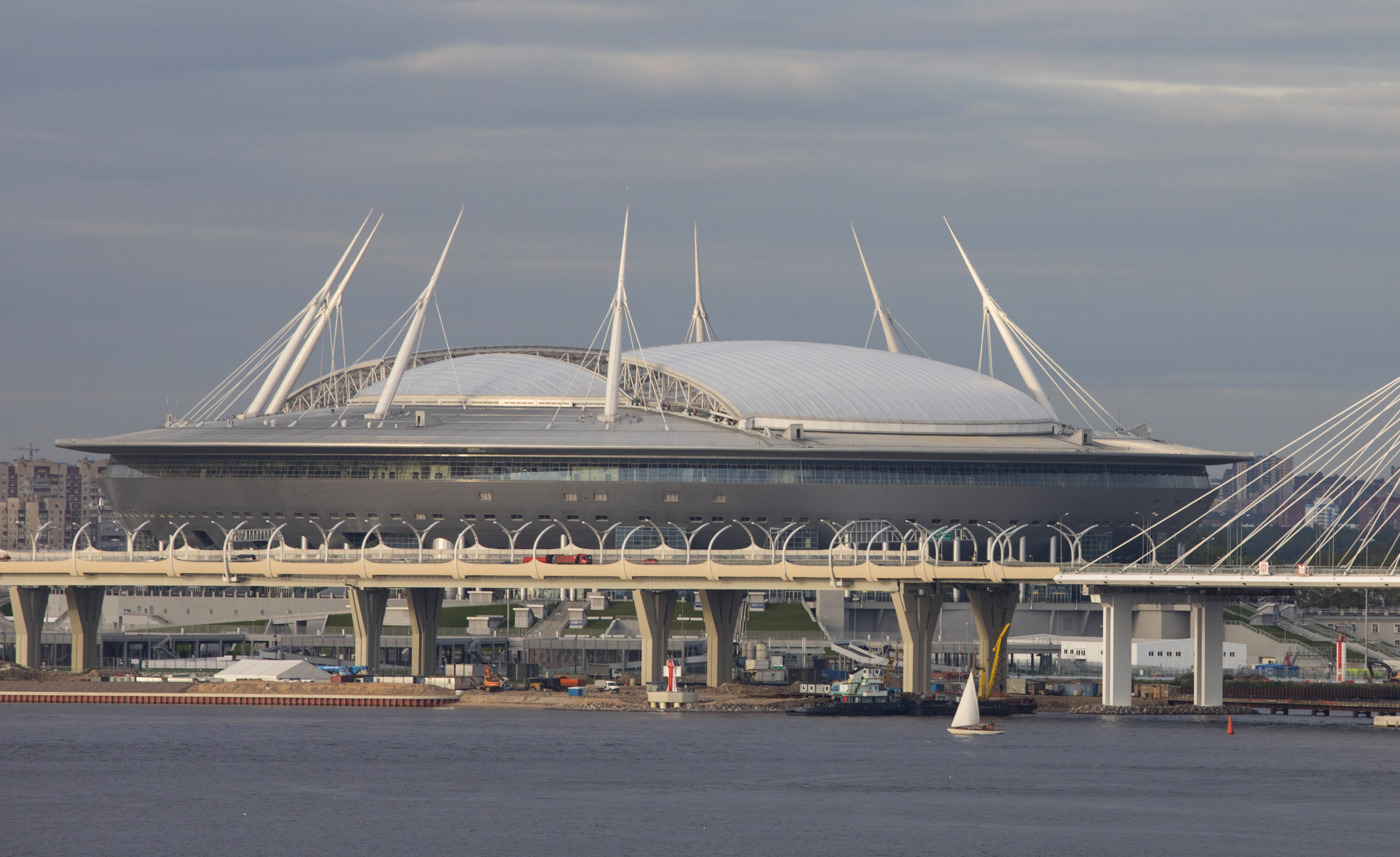 The Krestovsky Stadium is viewed looking from the Gulf of Finland in St. Petersburg, Russia, on Aug. 28, 2017. The soccer stadium has a retractable roof and is in the western part of Krestosky Island in St. Petersburg near the Gulf of Finland. The stadium will be know as Saint Petersburg Stadium during the 2018 FIFA World Cup. The stadium is near the new Gazprom headquarters. (AP Photo/Jon Elswick)