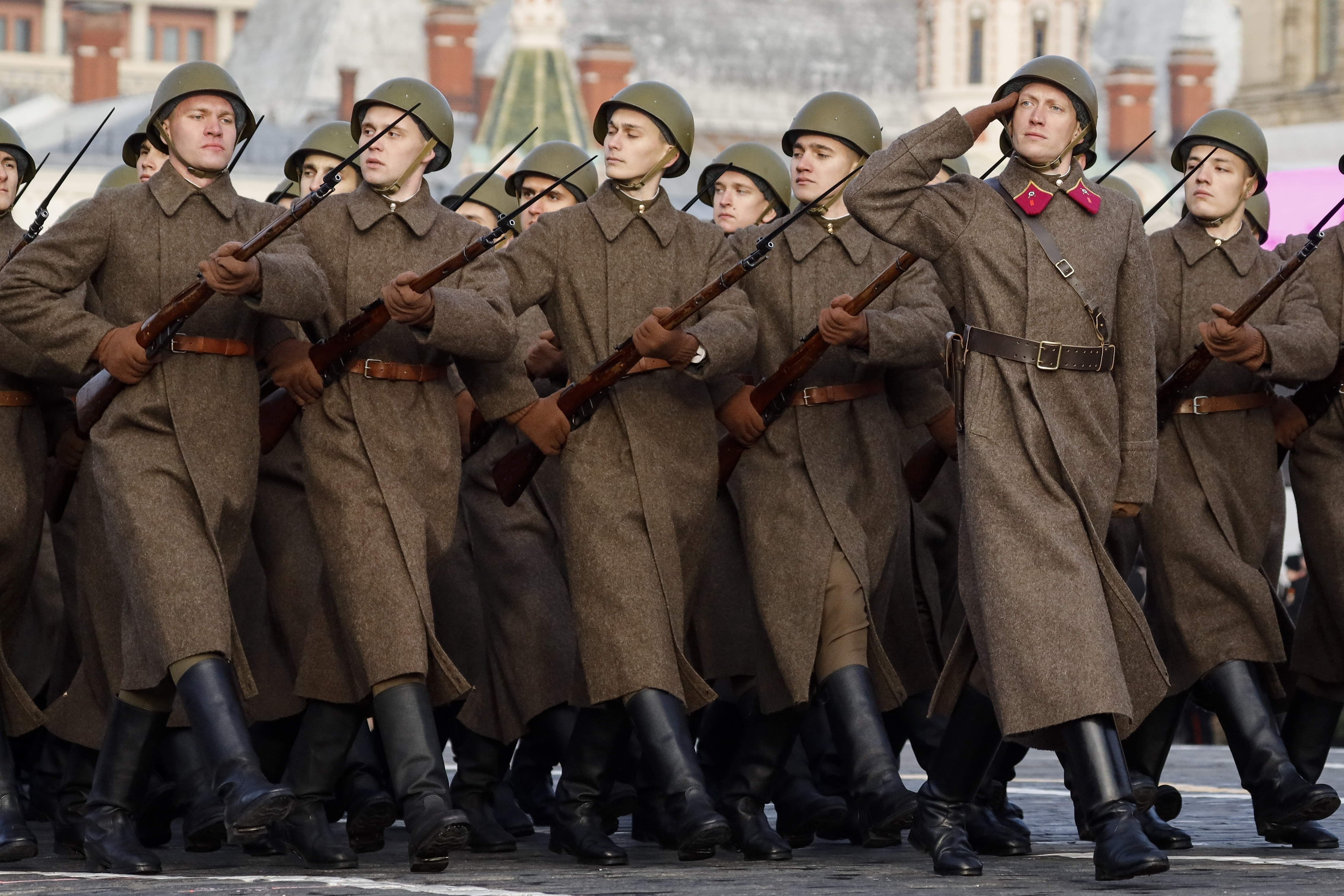 Russian soldiers dressed in Red Army World War II uniform march during the Nov. 7 parade in Red Square, in Moscow, Russia, Wednesday, Nov. 7, 2018. The event marked the 77th anniversary of a World War II historic parade in Red Square and honored the participants in the Nov. 7, 1941 parade who headed directly to the front lines to defend Moscow from the Nazi forces. (AP Photo/Alexander Zemlianichenko)