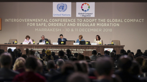 U.N. Secretary-General Antonio Guterres, 2nd left, and Moroccan Minister of Foreign Affairs and International Cooperation, Nasser Bourita, center, chair the opening session of a UN Migration Conference in Marrakech, Morocco, Monday, Dec.10, 2018. Top U.N. officials and government leaders from about 150 countries are uniting around an agreement on migration, while finding themselves on the defensive about the non-binding deal amid criticism and a walkout from the United States and some other countries. (AP Photo/Mosa'ab Elshamy)