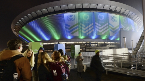 Participants in U.N. climate talks on ways of combating global warming leave the venue at the end of the day's session in Katowice, Poland, Wednesday, Dec. 12, 2018.(AP Photo/Czarek Sokolowski)