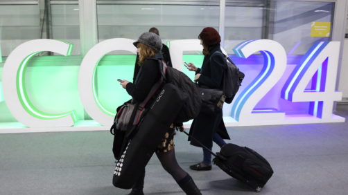 A participants leaves before the end of the final session of the COP24 summit on climate change in Katowice, Poland, Friday, Dec. 14, 2018.(AP Photo/Czarek Sokolowski)