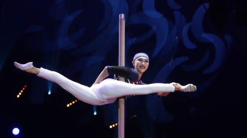 In this pool photo taken Thursday, Jan. 17, 2019, a member of the China National Acrobatic Troupe performs during the opening ceremony of the 43rd Monte-Carlo International Circus Festival in Monaco. The festival will run from Jan. 17 to 27. (Sebastien Nogier/Pool Photo via AP)