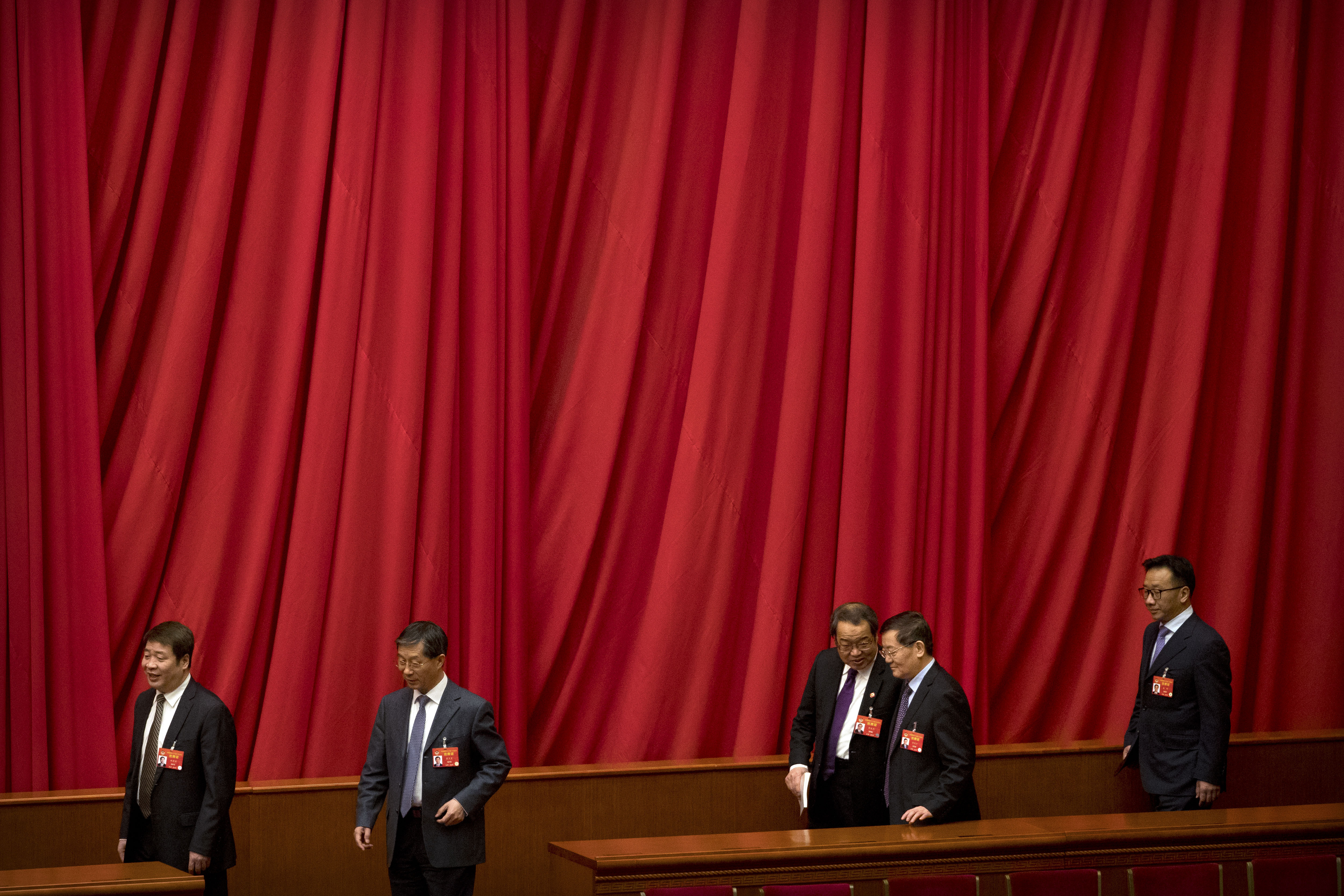 Delegates arrive for the closing session of the Chinese People's Political Consultative Conference (CPPCC) at the Great Hall of the People in Beijing, Wednesday, March 13, 2019. (AP Photo/Mark Schiefelbein)