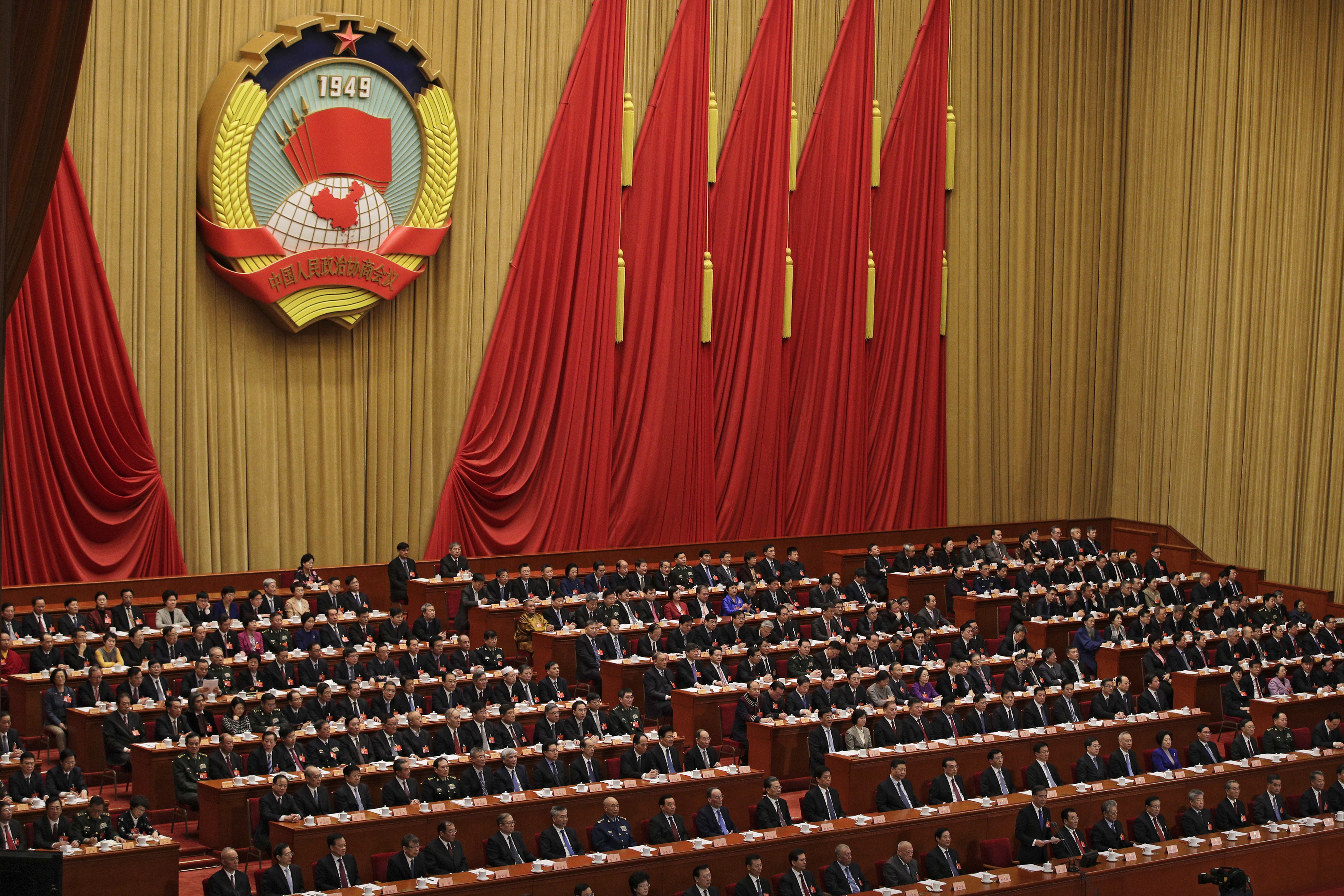 Chinese People's Political Consultative Conference (CPPCC) chairman and Politburo Standing Committee member Wang Yang delivers a closing speech for the Chinese People's Political Consultative Conference (CPPCC) at the Great Hall of the People in Beijing, Wednesday, March 13, 2019. (AP Photo/Andy Wong)