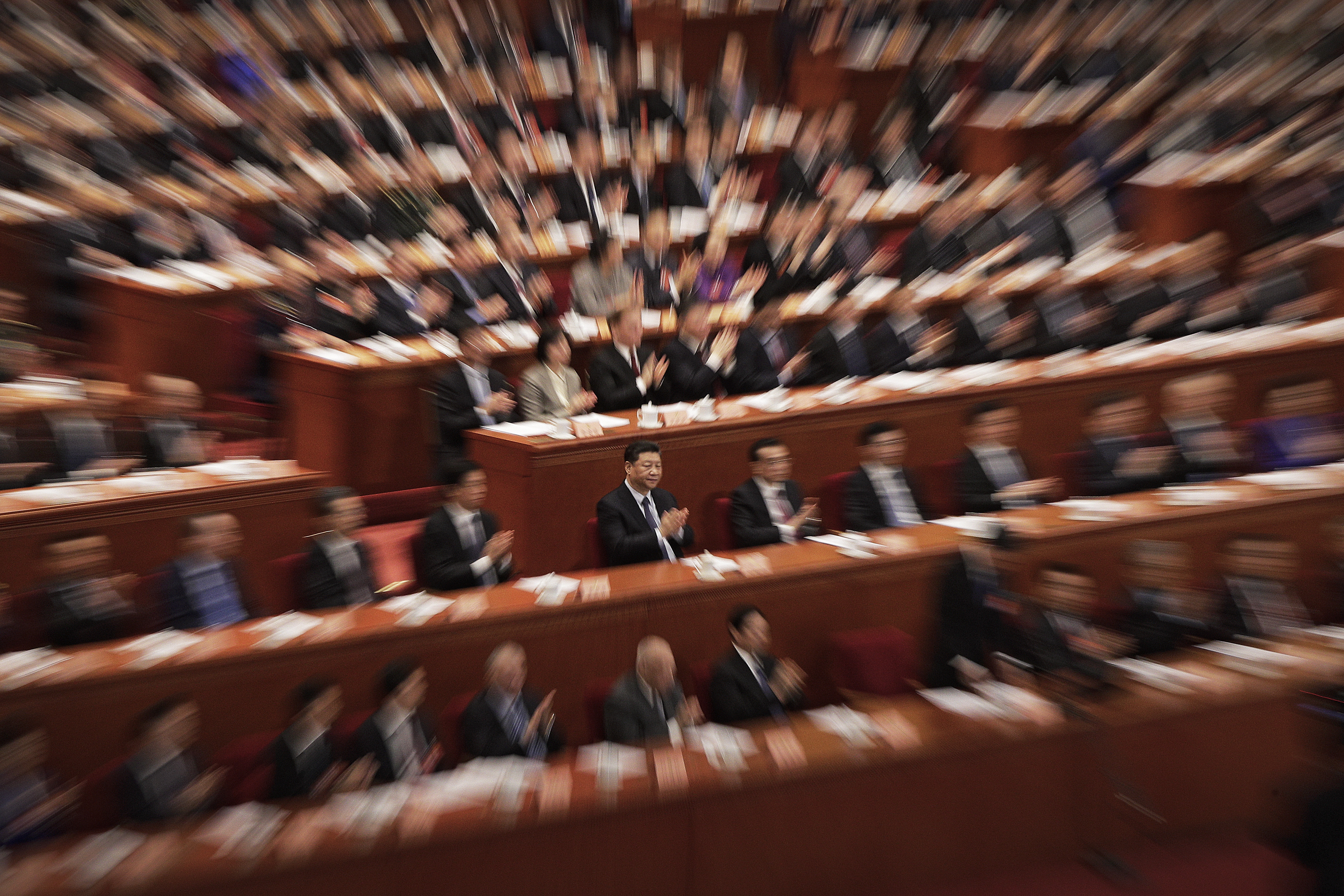 Chinese President Xi Jinping, center, and leaders applaud as Chinese People's Political Consultative Conference (CPPCC) chairman and Politburo Standing Committee member Wang Yang delivers a closing speech for CPPCC at the Great Hall of the People in Beijing, Wednesday, March 13, 2019. (AP Photo/Andy Wong)