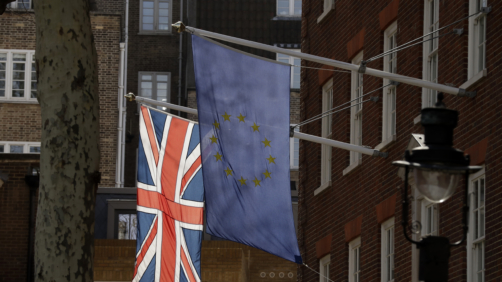 A European flag and a British Union flag hang outside Europe House, the European Parliament's British offices in London, Monday, March 18, 2019. British Prime Minister Theresa May was making a last-minute push Monday to win support for her European Union divorce deal, warning opponents that failure to approve it would mean a long — and possibly indefinite — delay to Brexit. Parliament has rejected the agreement twice, but May aims to try a third time this week if she can persuade enough lawmakers to change their minds. (AP Photo/Matt Dunham)