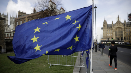 A European flag placed by anti-Brexit remain in the European Union supporters flies backdropped by the Houses of Parliament, at right, in London, Monday, March 18, 2019. British Prime Minister Theresa May was making a last-minute push Monday to win support for her European Union divorce deal, warning opponents that failure to approve it would mean a long — and possibly indefinite — delay to Brexit. Parliament has rejected the agreement twice, but May aims to try a third time this week if she can persuade enough lawmakers to change their minds. (AP Photo/Matt Dunham)