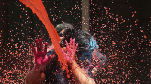 Colored water is splashed on a woman during Holi festivities in Allahabad, India, Thursday, March 21, 2019. This exuberant festival originally held to celebrate the fertility of the land, is also associated with the immortal love of Hindu God Krishna and Radha. Holi celebration is an excuse for Indians to shed inhibitions for a day of spring fever and big fun. (AP Photo/Rajesh Kumar Singh)