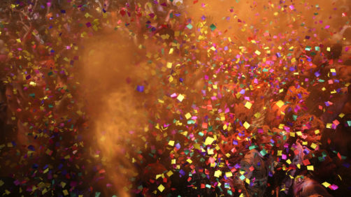 Indian revelers dance as colored powder and confetti are showered on them during celebrations to mark Holi, the Hindu festival of colors, in Prayagraj, India, Friday, March 22, 2019. Indians on Thursday celebrated Holi, the riotous annual celebration of color, that marks the end of winter and the arrival of spring. People armed with water balloons, colored water and powder in multiple hues played Holi by smearing each other's faces with color. (AP Photo/ Rajesh Kumar Singh)