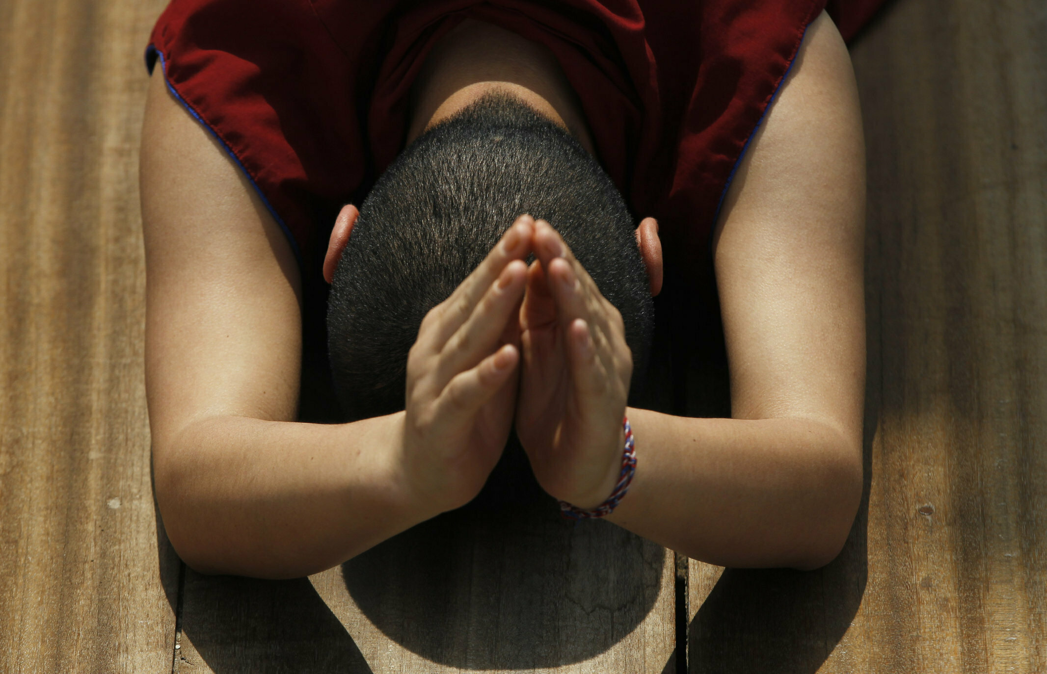 A Buddhist nun prostrates performing Buddhist religious rituals during Buddha Jayanti, or Buddha Purnima, festival in Kathmandu, Nepal, Saturday, May 18, 2019. The festival marks the triple events of Gautam Buddha's life: his birth, his enlightenment and his attaining a state of Nirvana that frees believers from the circle of death and rebirth. (AP Photo/Niranjan Shrestha)