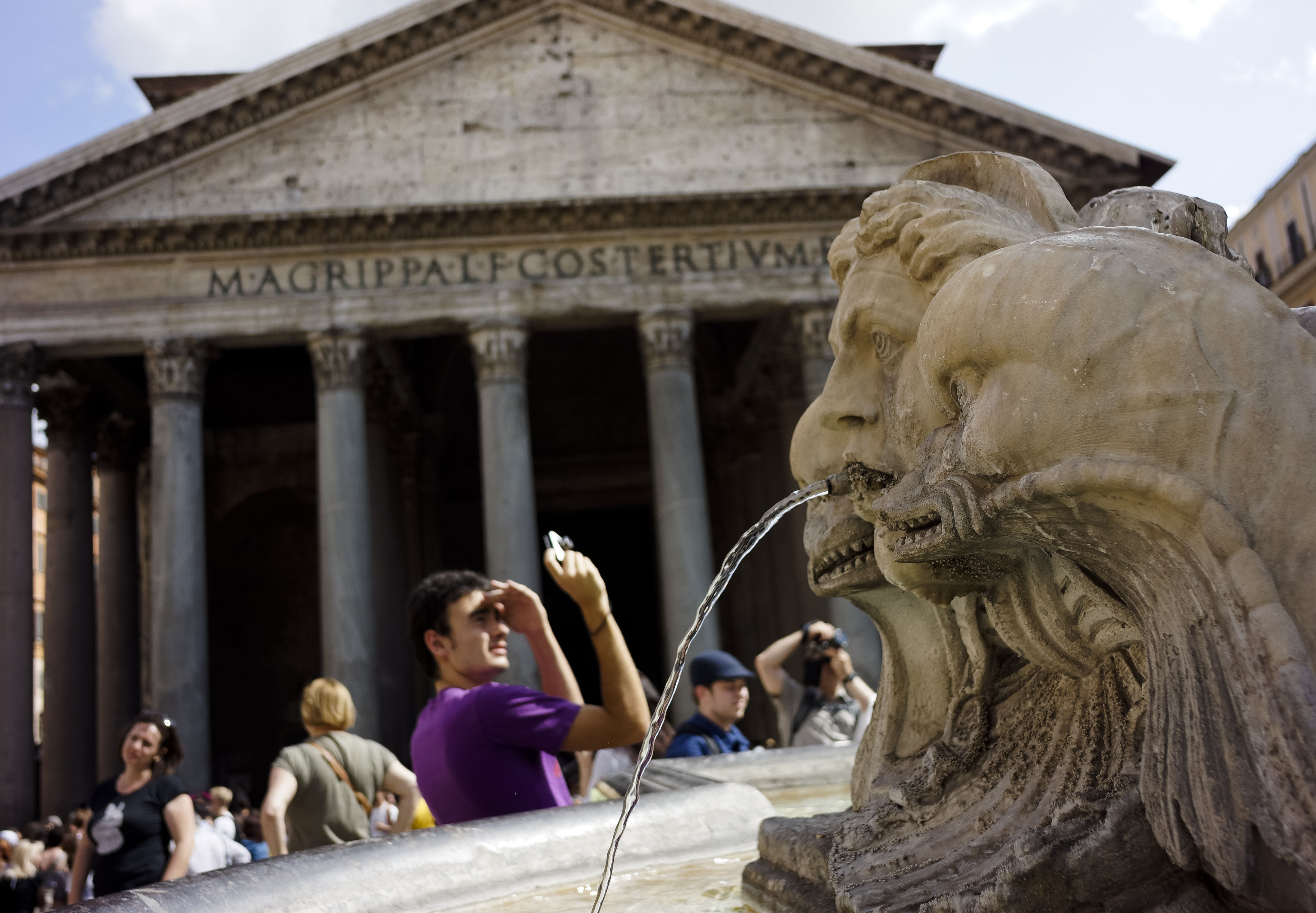 A man is framed by Giacomo Della Porta's 16th century fountain in Piazza della Rotonda, Rome, as he snaps a picture in front of the Pantheon, Friday, June 28, 2013. The Pantheon was built under Emperor Augustus between 27 and 25 b.C., to celebrate all the gods worshipped in Ancient Rome. (AP Photo, Domenico Stinellis)