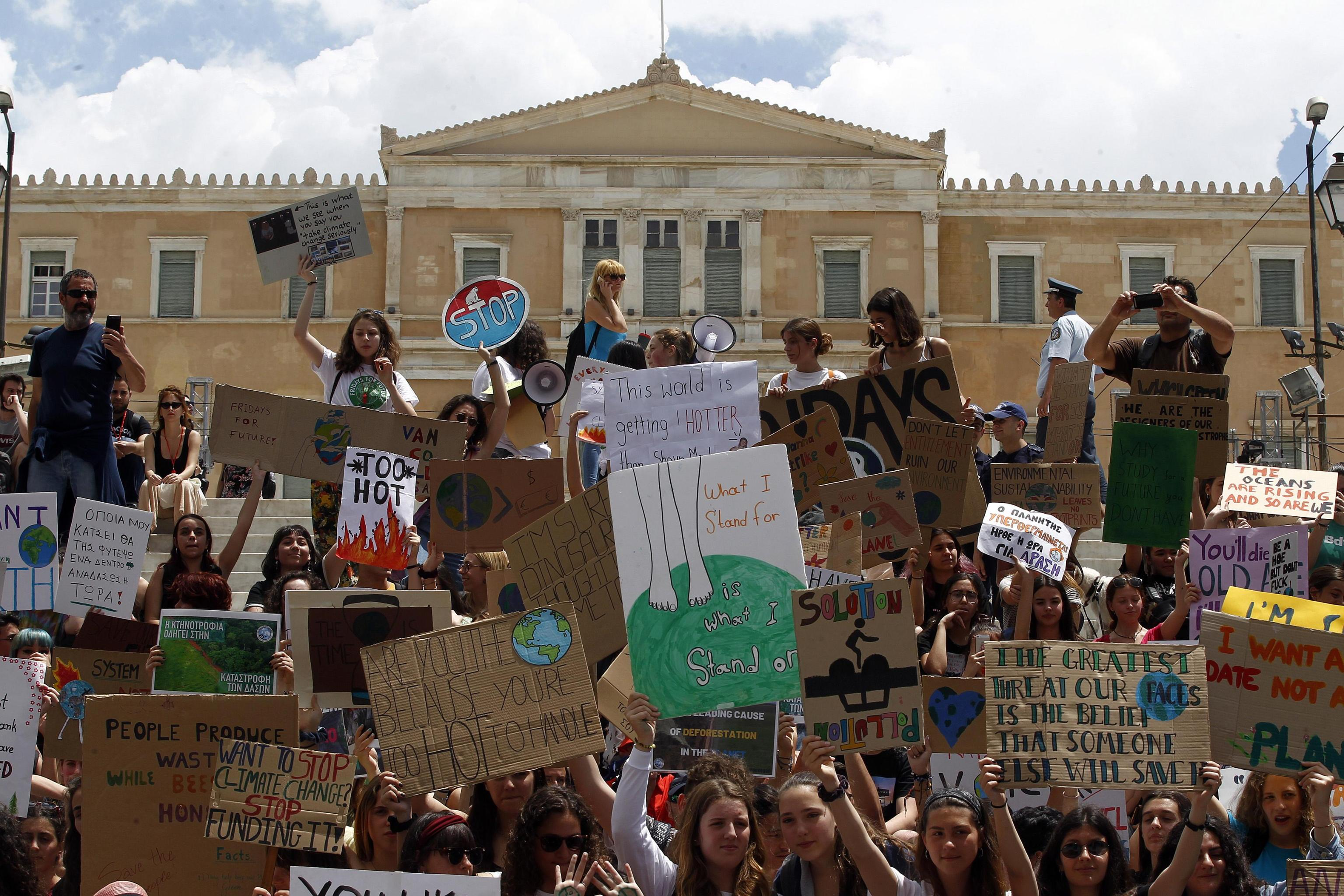 epa07597089 Students take part in a demonstration against climate change during a 'Fridays for Future' in front of the greek parliament, in Athens, Greece, 24 May 2019. Youth and students across the world are taking part in a student strike movement called #FridayForFuture which was sparked by Greta Thunberg of Sweden, a sixteen year old climate activist who has been protesting outside the Swedish parliament every Friday since August 2018.  EPA/ALEXANDROS VLACHOS