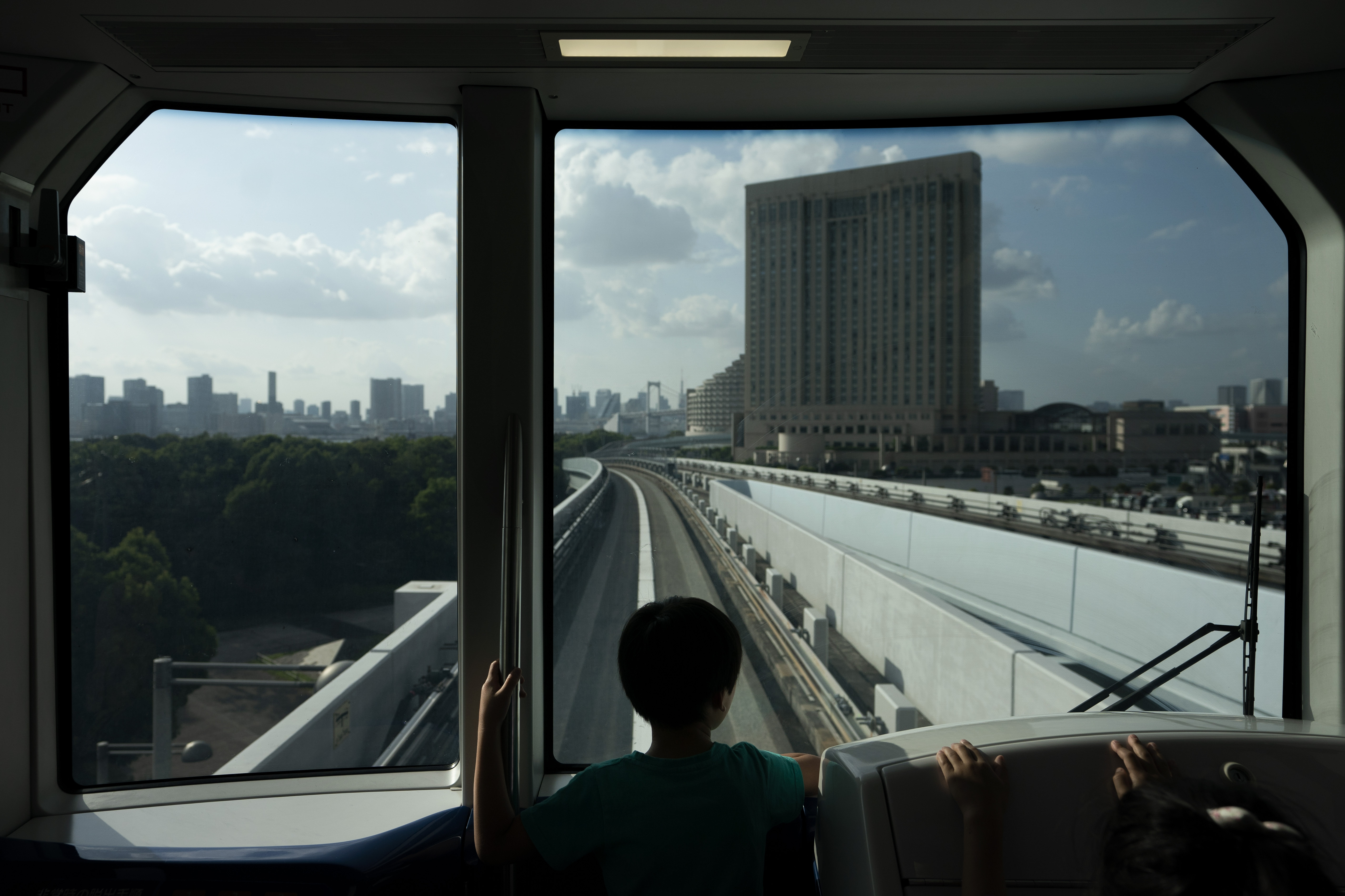 A young boy views the Tokyo skyline in the distance from a train running along the Yurikamome line Sunday, May 19, 2019, in Tokyo. (AP Photo/Jae C. Hong)