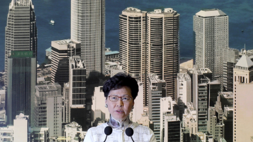 Hong Kong's Chief Executive Carrie Lam arrives holds a press conference in Hong Kong on Saturday, June 15, 2019. Lam said she will suspend a proposed extradition bill indefinitely in response to widespread public unhappiness over the measure, which would enable authorities to send some suspects to stand trial in mainland courts. (AP Photo/Kin Cheung)