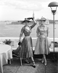 Models wearing Christian Dior fashions near the Piazza San Marco in Venice, 3rd June 1951. The island of San Giorgio Maggiore is visible in the background. (Photo by Archivio Cameraphoto Epoche/Getty Images)