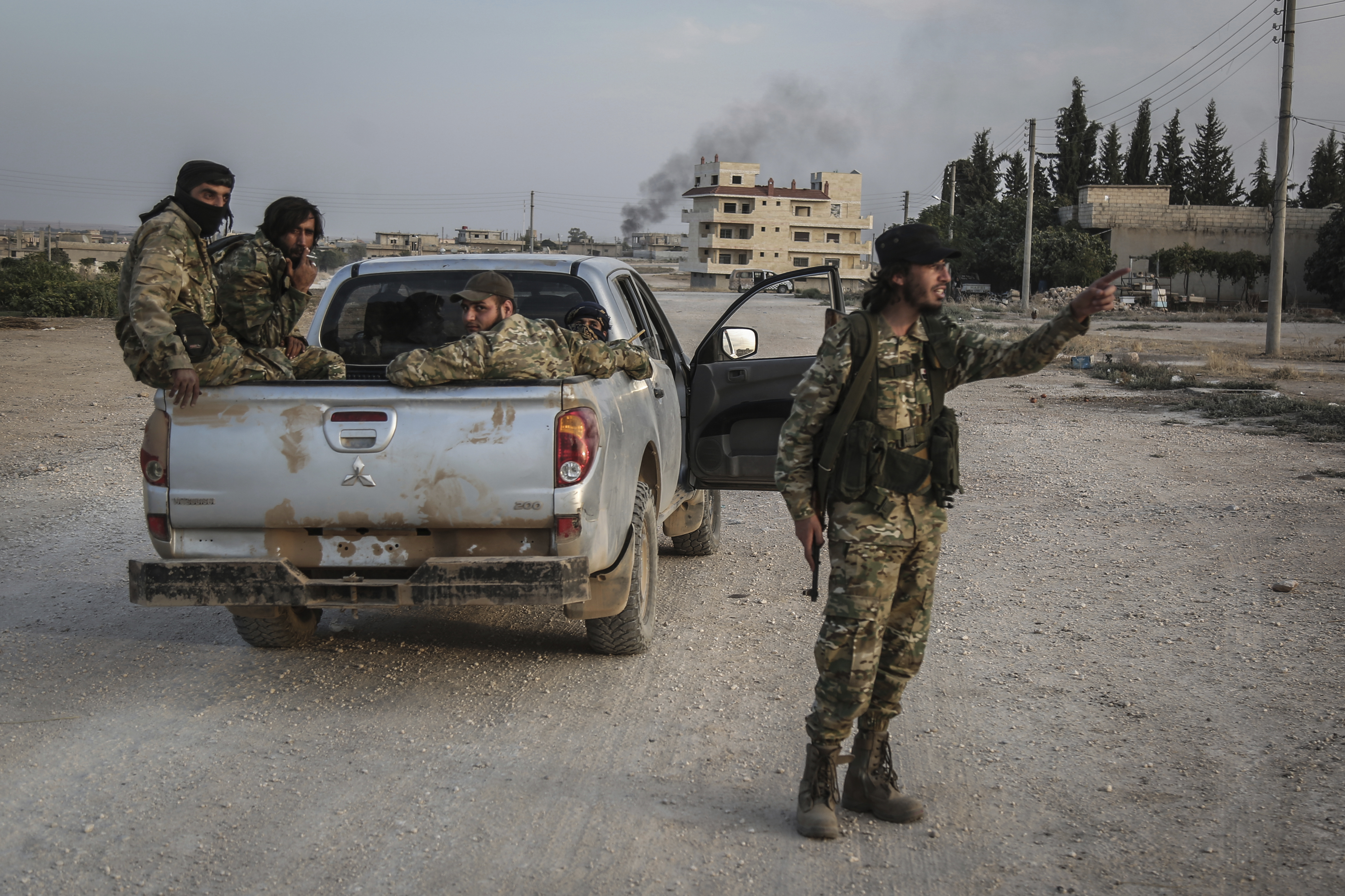 14 October 2019, Syria, Tell Abiad: Soldiers of the Turkish-backed Syrian National Army patrol a street after clashes with Kurdish fighters. Photo by: Anas Alkharboutli/picture-alliance/dpa/AP Images