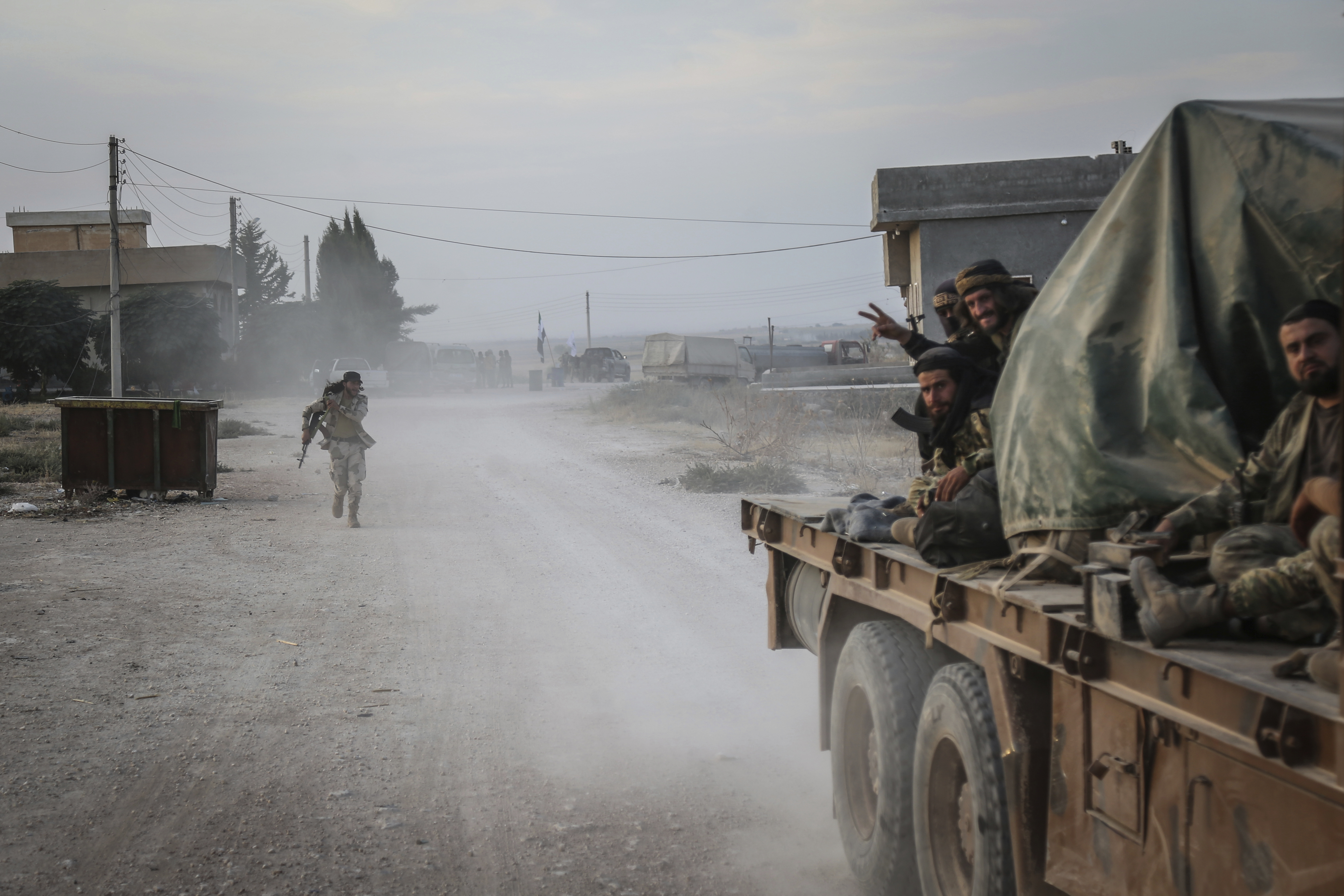 14 October 2019, Syria, Tell Abiad: Soldiers of the Turkish-backed Syrian National Army gesture after clashes with Kurdish fighters. Photo by: Anas Alkharboutli/picture-alliance/dpa/AP Images
