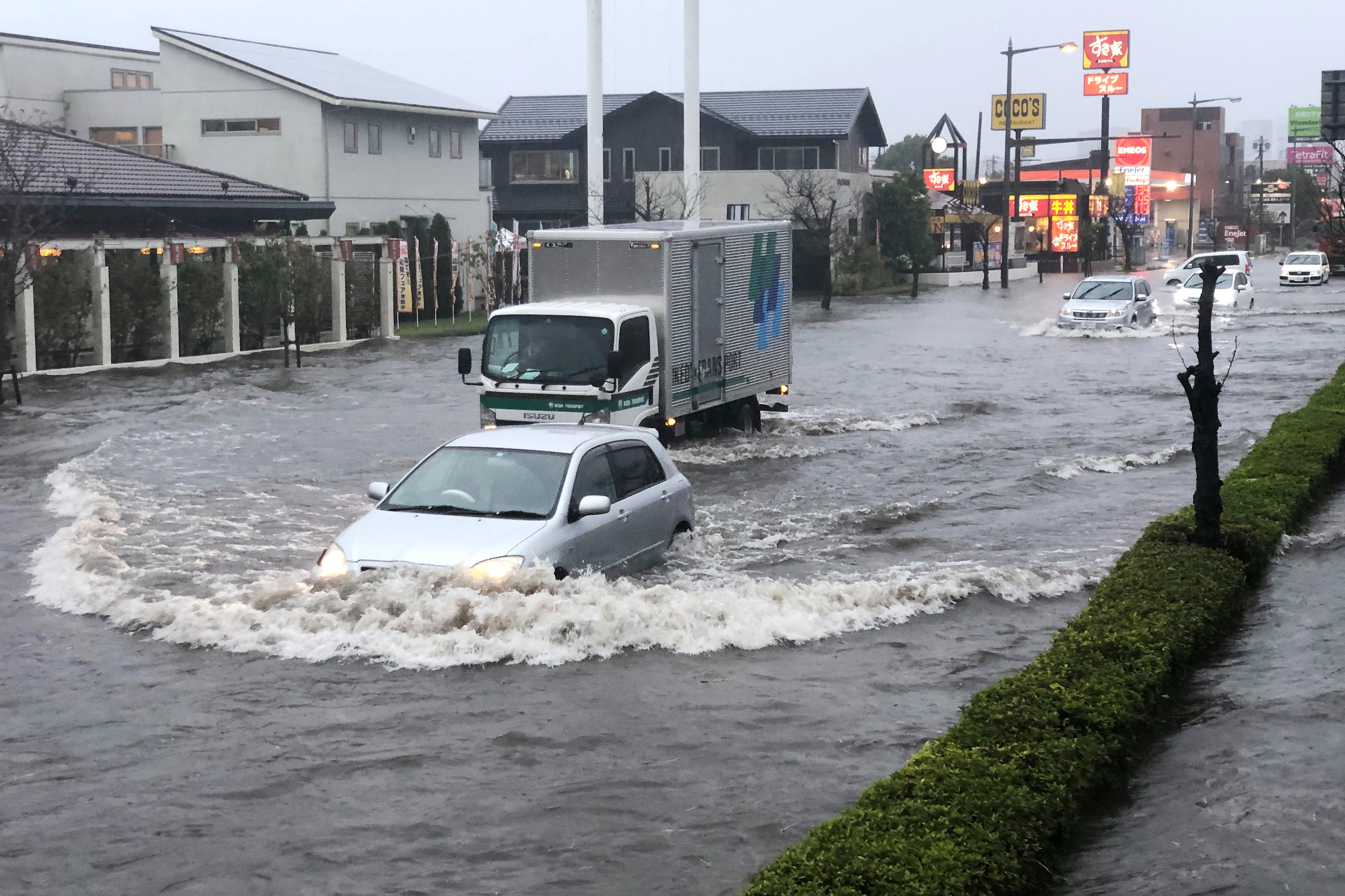 A street is flooded by heavy rain Friday, Oct. 25, 2019, in Narita, east of Tokyo. Torrential rain dumped from a low-pressure system hovering above Japan's main island has triggered flooding in towns east of Tokyo, prompting fears of more damage to areas already hit by typhoons earlier this month. (AP Photo/Lee Jin-man)
