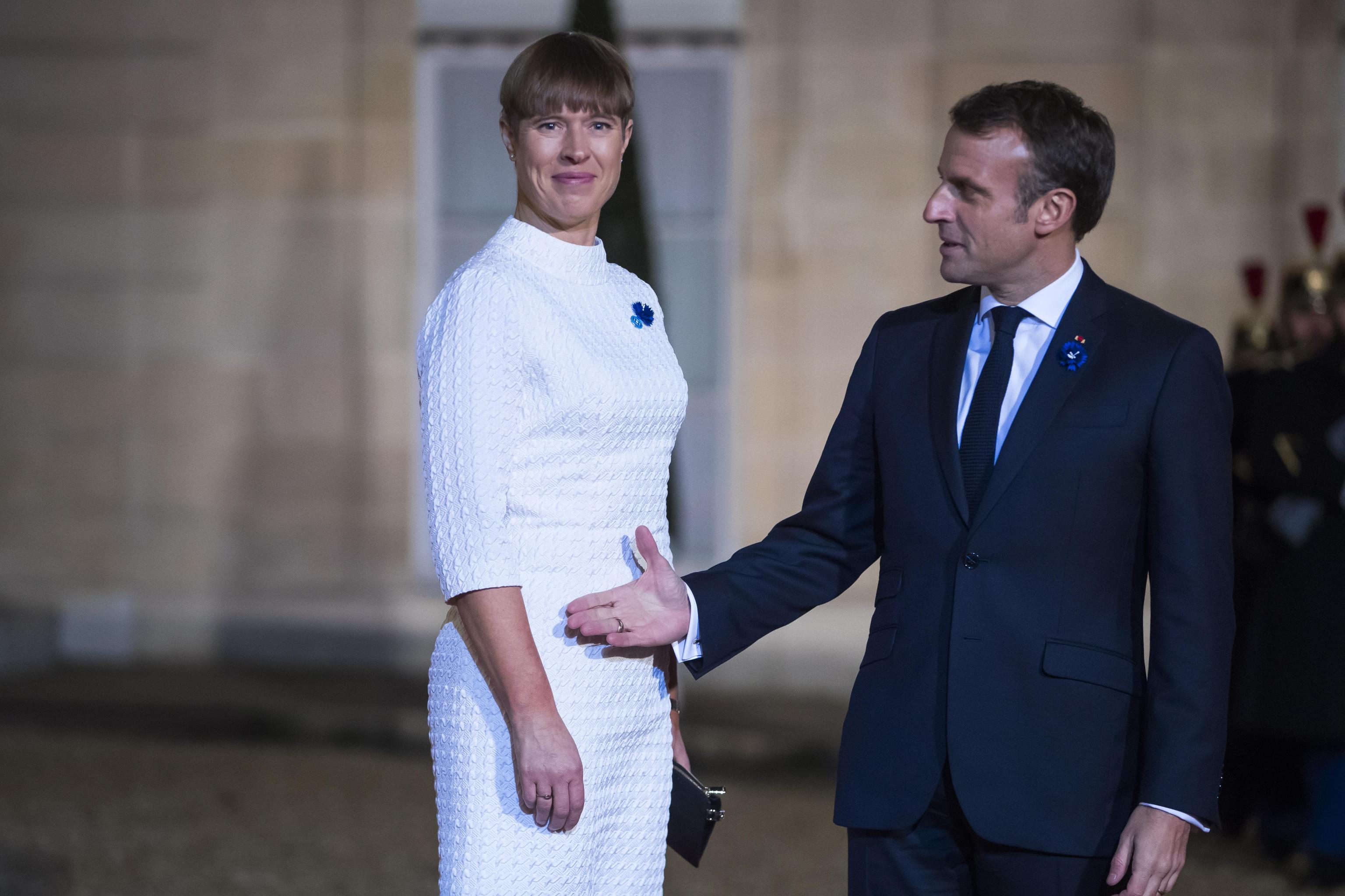 epa07989435 French President Emmanuel Macron (R) welcomes Estonian president Kersti Kaljulaid (L) for a dinner held with participants of the Paris Peace Forum, at the Elysee Palace, in Paris, France, 11 November 2019.  EPA/CHRISTOPHE PETIT TESSON