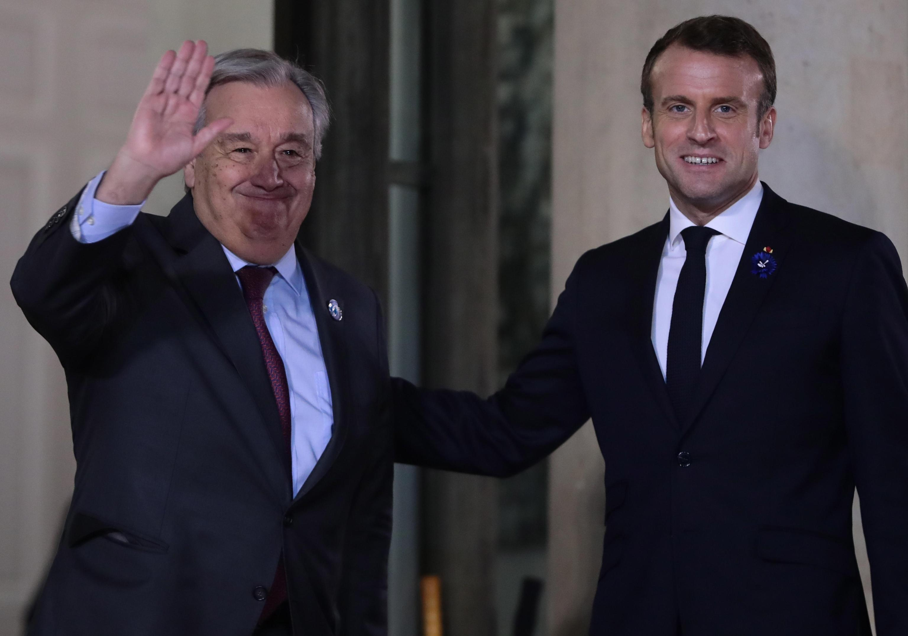 epa07989128 President Emmanuel Macron (R) greets UN Secretary-General Antonio Guterres (L) for a dinner with participants of the Paris Peace Forum, at the Elysee Palace, in Paris, France, 11 November 2019.  EPA/CHRISTOPHE PETIT TESSON