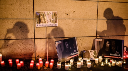epa07925849 Filming participants cast shadows onto candles and and cardboards with photos during a picket in front of the Maltese embassy for murdered journalist Daphne Caruana Galizia in Berlin, Germany, 16 October 2019. Reporters Without Borders organized a picket for murdered journalist Daphne Caruana Galizia, who was killed on 16 October 2017 in Malta, while investigating the Panama Papers case.  EPA/CLEMENS BILAN