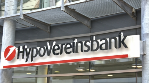 The illuminated sign of a HypoVereinbank branch in Schleswig. HypoVereinsbank is the brand of Unicredit Bank AG with headquarters in Munich. --- For editorial use only --- Only for editorial use! | usage worldwide Photo by: Torsten Sukrow/SULUPRESS.DE/picture-alliance/dpa/AP Images