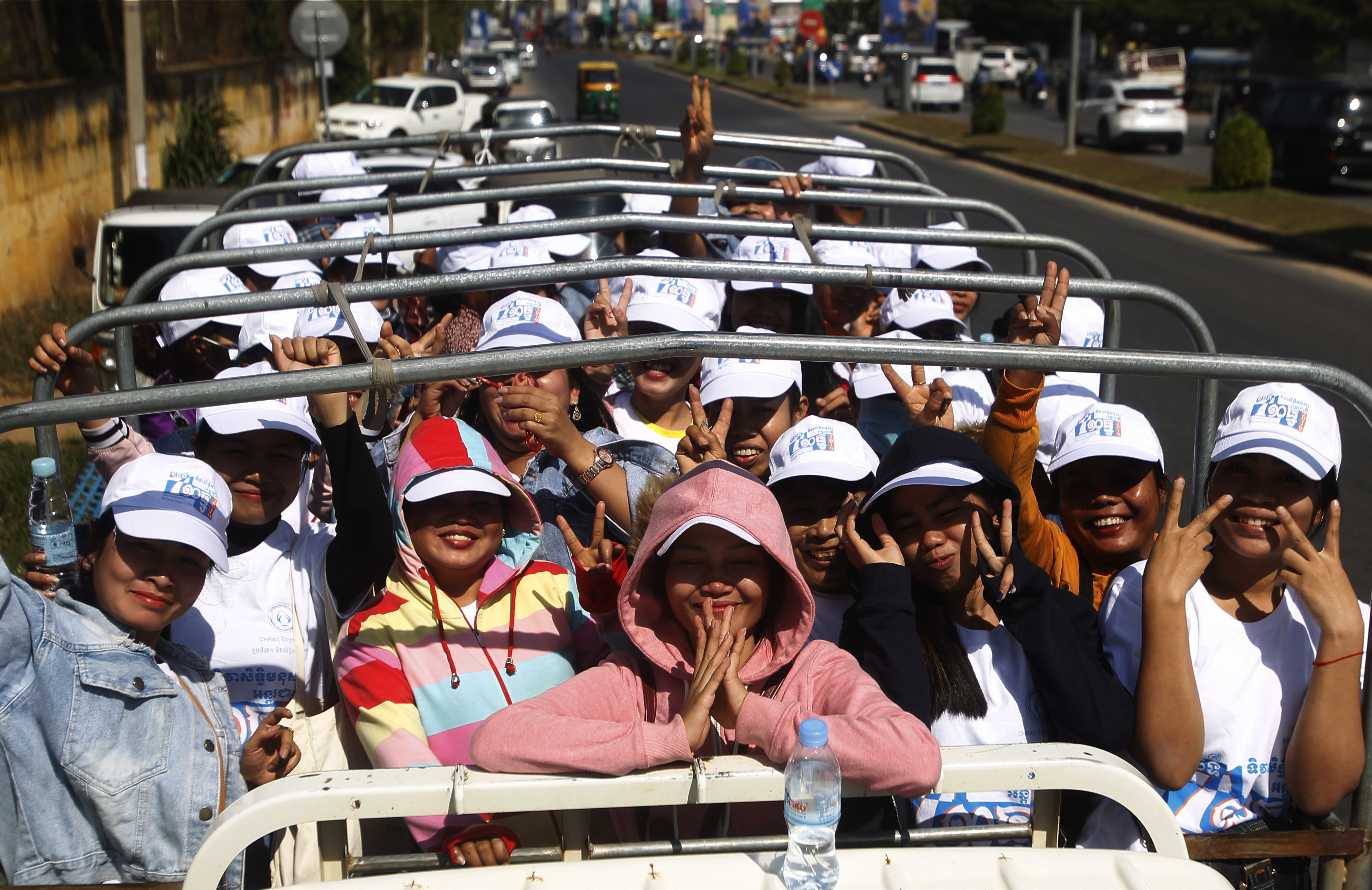 Cambodian factory workers stand on a truck after they participate in a celebration to mark the Human Rights Day at Democracy Square in Phnom Penh, Cambodia, Tuesday, Dec. 10, 2019. The United Nation's adopted Dec. 10 as the international human rights day in 1948 and has been observed annually ever since. (AP Photo/Heng Sinith)