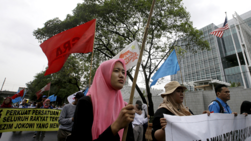 Activists march during rally to mark the Human Rights Day outside U.S. embassy in Jakarta, Indonesia, Tuesday, Dec. 10, 2019. Rights activists marched in Indonesia's capital Tuesday, calling on the government of the world's most populous Muslim and third largest democracy to protect and respect human rights.(AP Photo/Achmad Ibrahim)