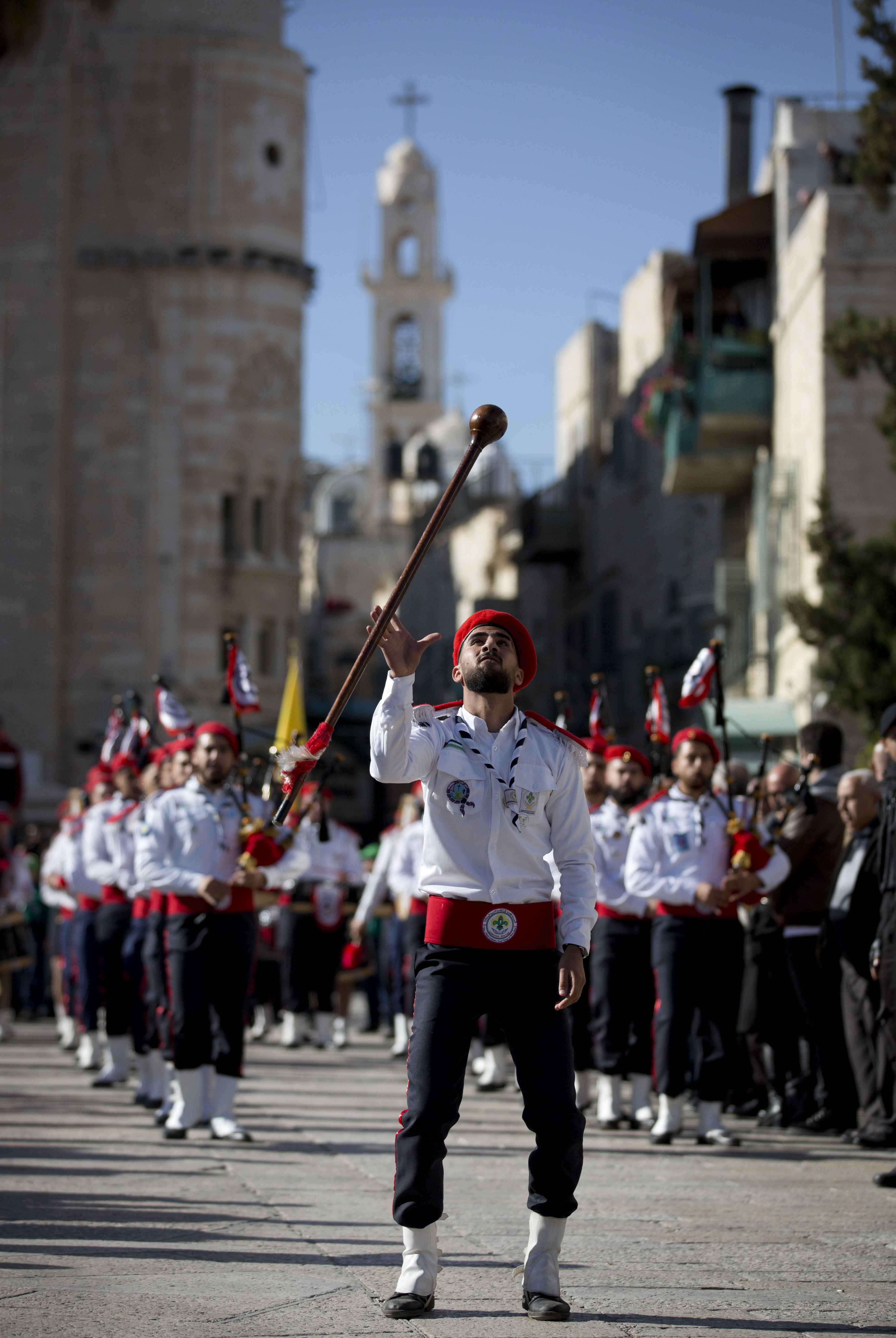 A Palestinian Scout marching band parade during Christmas celebrations outside the Church of the Nativity, built atop the site where Christians believe Jesus Christ was born, on Christmas Eve, in the West Bank City of Bethlehem, Tuesday, Dec. 24, 2019. (AP Photo/Majdi Mohammed)