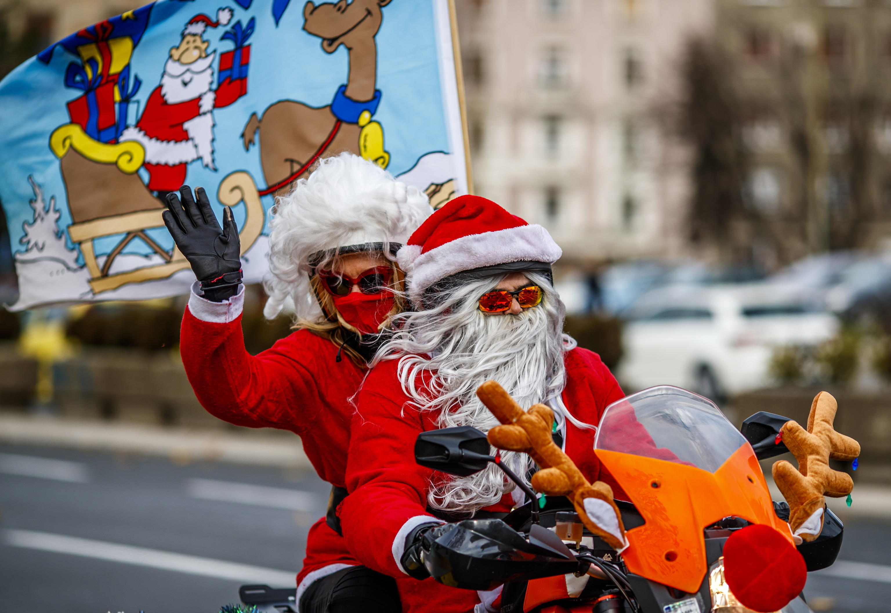 epa08084750 A Serbian motorcyclists dressed in Santa costume drive through the streets of the city center of Belgrade, Serbia, 21 December 2019. A group of Serbian motorcycle enthusiasts gathered in the Serbian capital for a joint ride to the bring Christmas gifts for underprivileged children.  EPA/SRDJAN SUKI