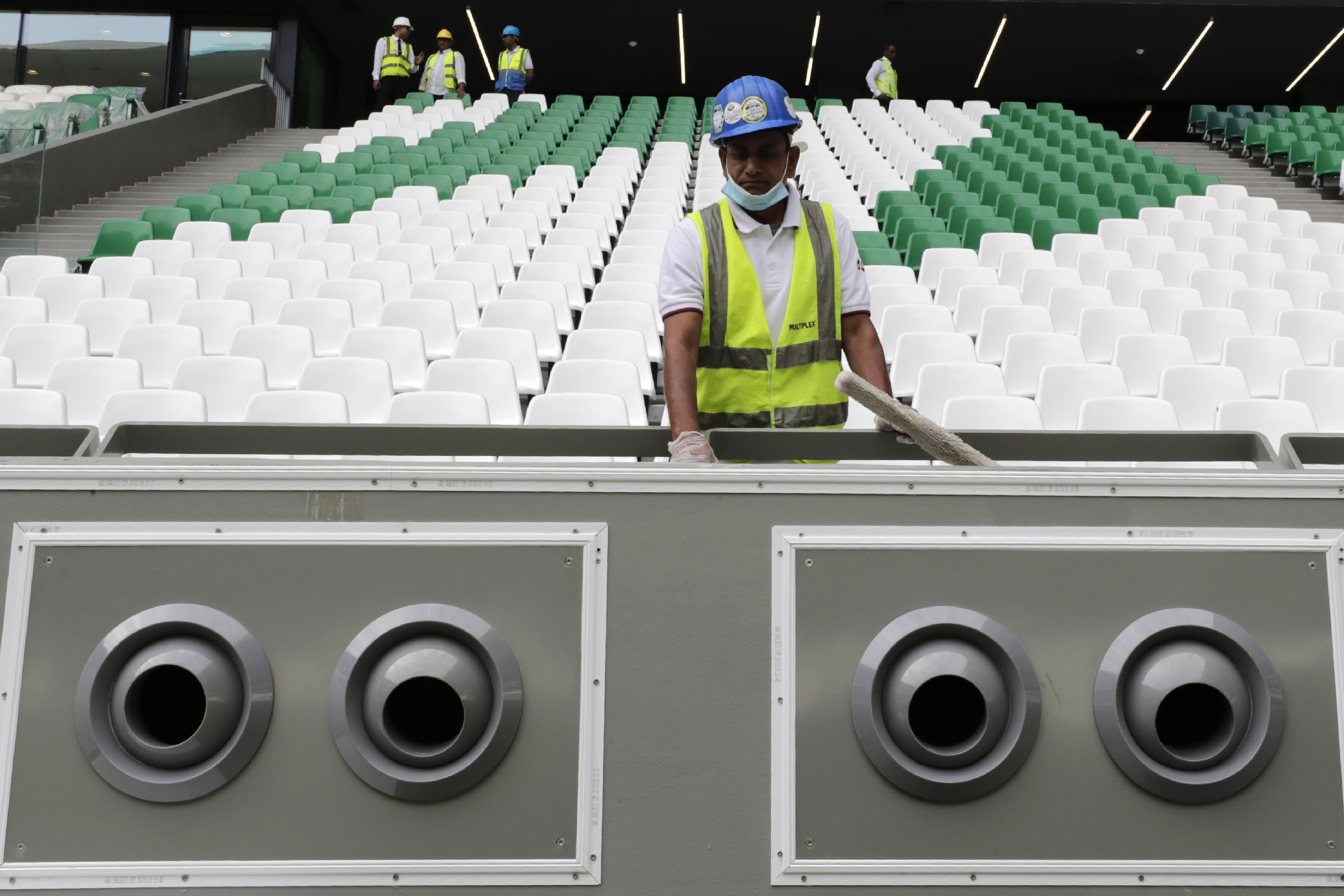 A worker cleans over a giant air conditioning at the Qatar Education Stadium, one of the 2022 World Cup stadiums, an open cooled stadium with a 45,350-seat capacity in Doha, Qatar, Sunday, Dec. 15, 2019. Qatar Education Stadium it isan open cooled stadium with a 45,350-seat capacity and is located in the middle of several university campuses at the Qatar Foundation's Education City in Doha. (AP Photo/Hassan Ammar)