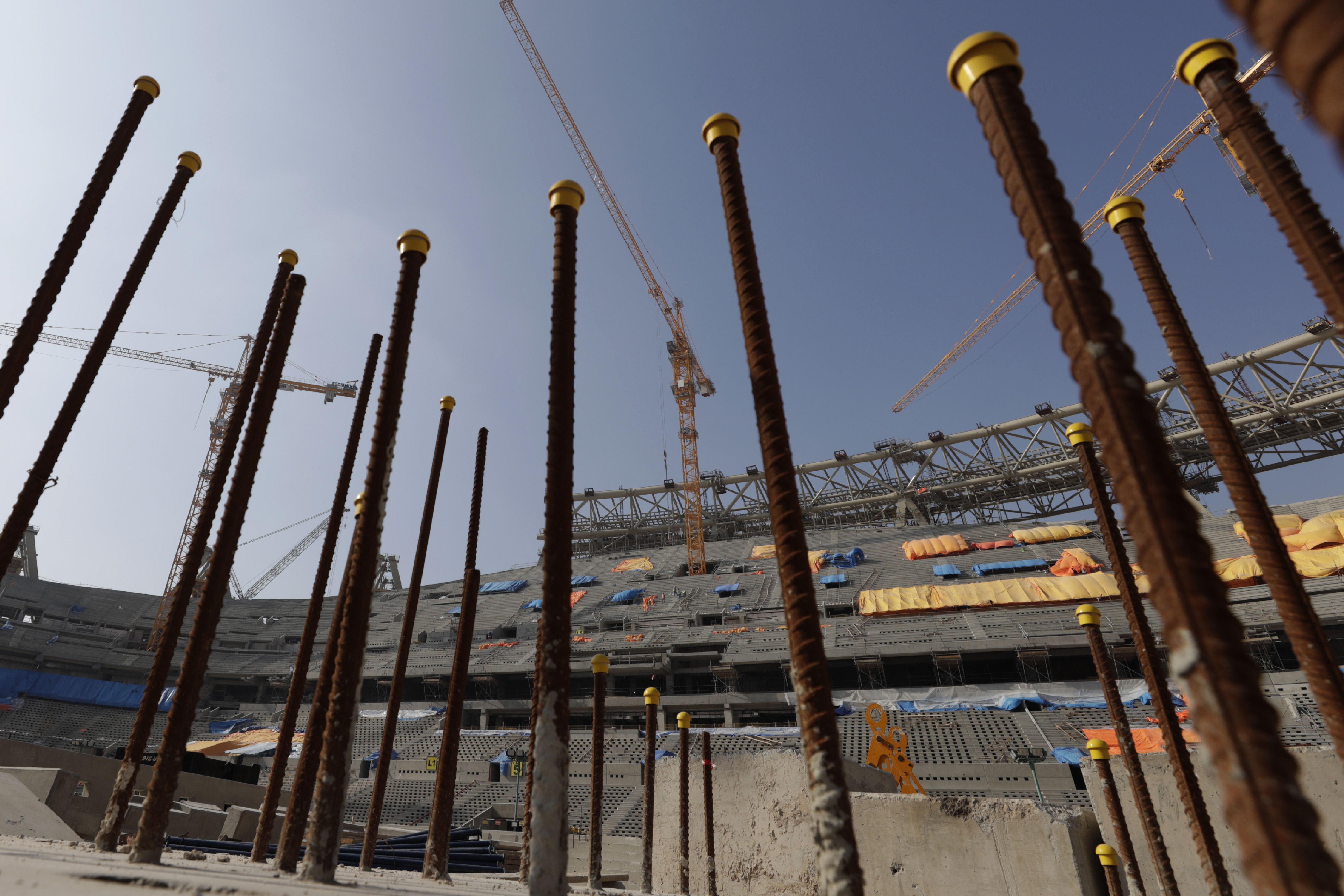 Workers work at Lusail Stadium, one of the 2022 World Cup stadiums, in Lusail, Qatar, Friday, Dec. 20, 2019. Construction is underway to complete Lusail's 80,000-seat venue for the opening game and final in a city that didn't exist when Qatar won the FIFA vote in 2010. (AP Photo/Hassan Ammar)