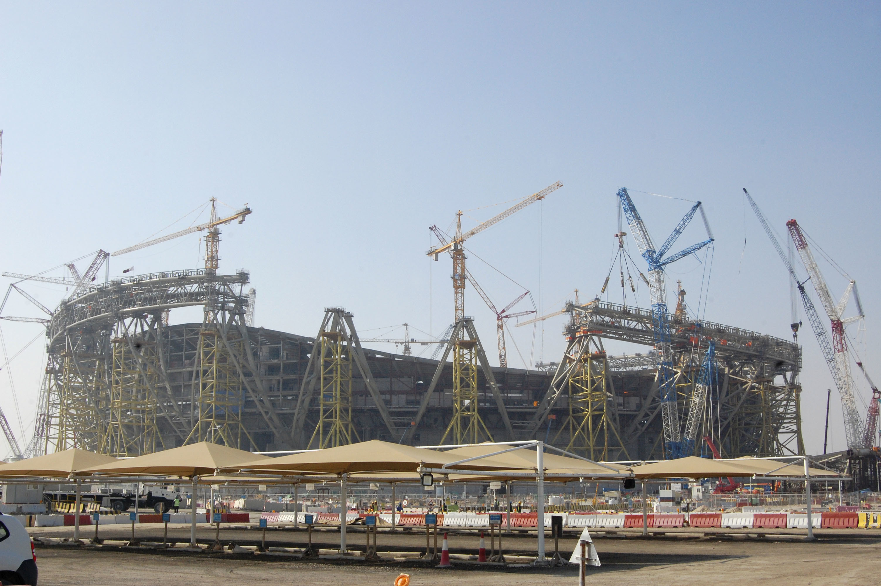 Photo taken Dec. 20, 2019, in Doha, shows Lusail Stadium -- which is scheduled to host the opening and final matches of the 2022 FIFA World Cup -- under construction. (Kyodo via AP Images) ==Kyodo